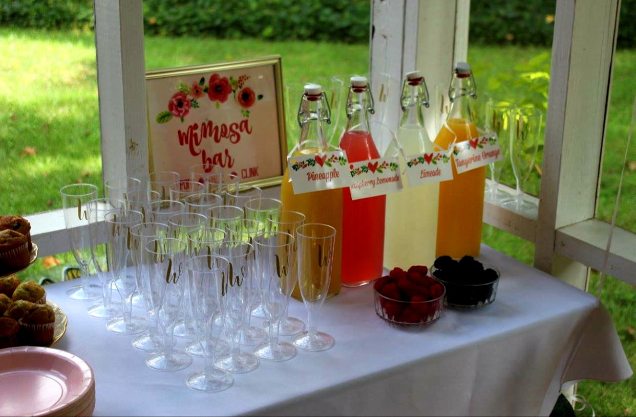 "What is a bridal shower without some champagne?! I bought a TON of plastic champagne glasses and added ""W"" to create a custom vibe! With juice choices and fruit toppers, we had ourselves a mimosa bar that flowed the entire morning!"