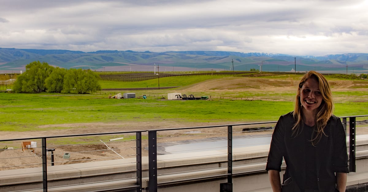 Hospitality Director Kaleigh Vrapi on the deck in front of the outstanding view of the Blue Mountains.