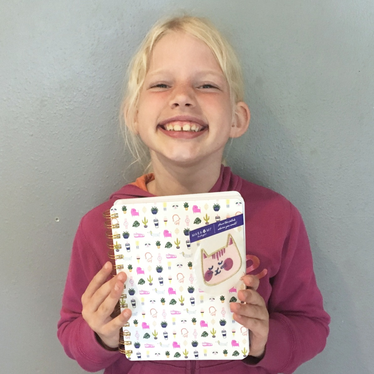 Eden (7) with her new writing journal. She is very excited about it!