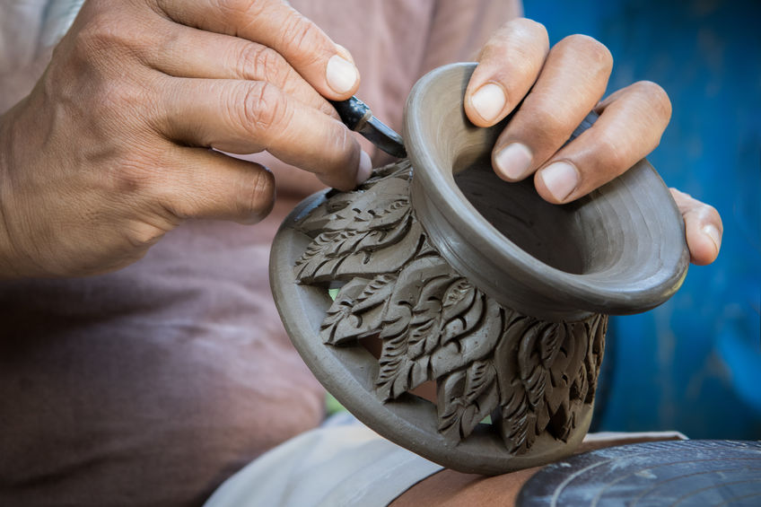 clay potter carving.jpg