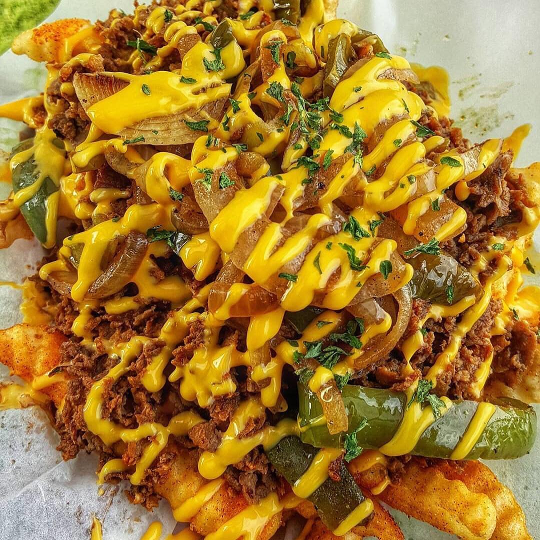 Philly Steak Fries - Sliced Philly Steak, Grilled Onions, Bell Peppers, Cheddar Cheese Sauce on Crinkle Cut Fries