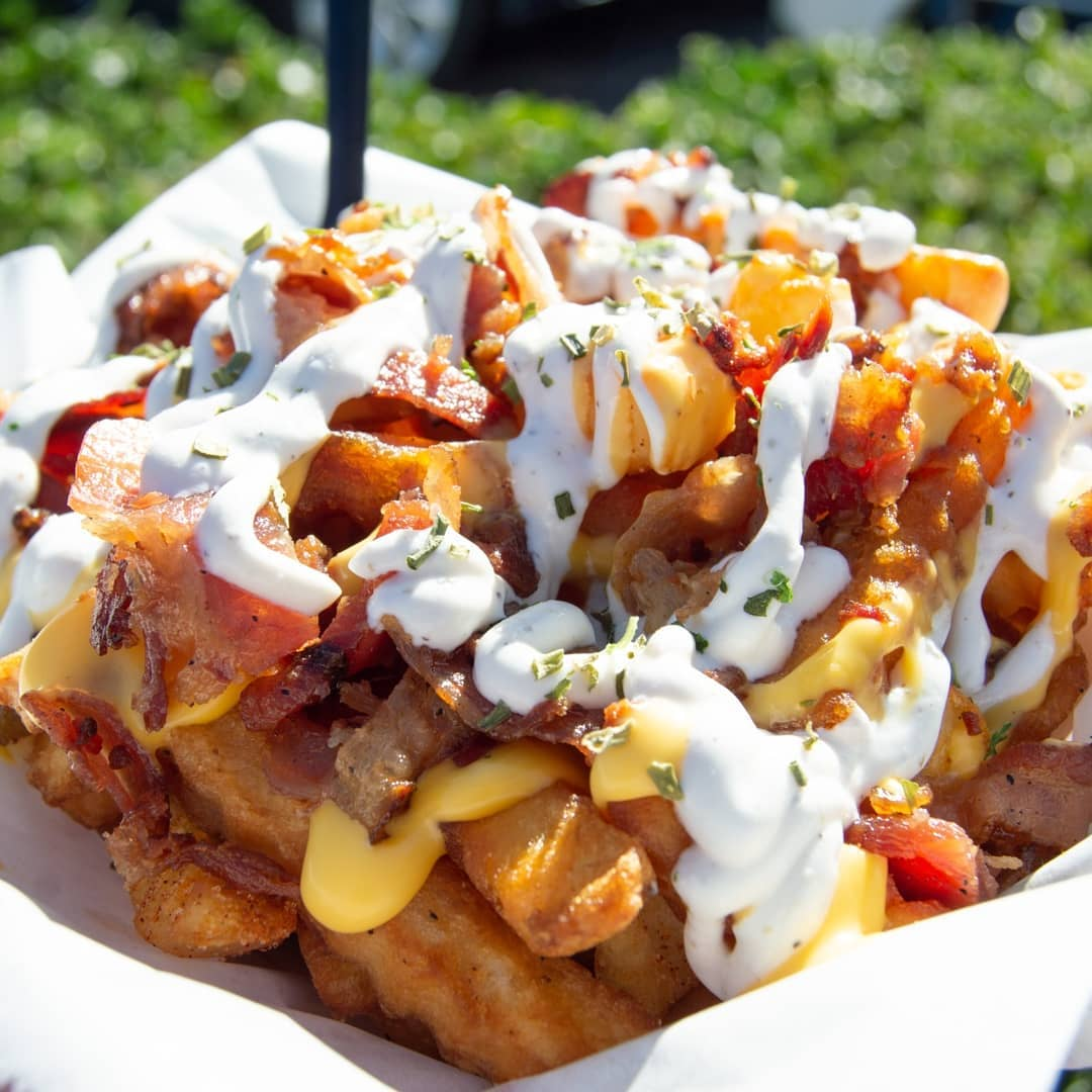 Irish Nachos - Crispy Bacon, Lime Sour Cream Sauce, Cheddar Cheese Sauce and chives on Crinkle Cut Fries