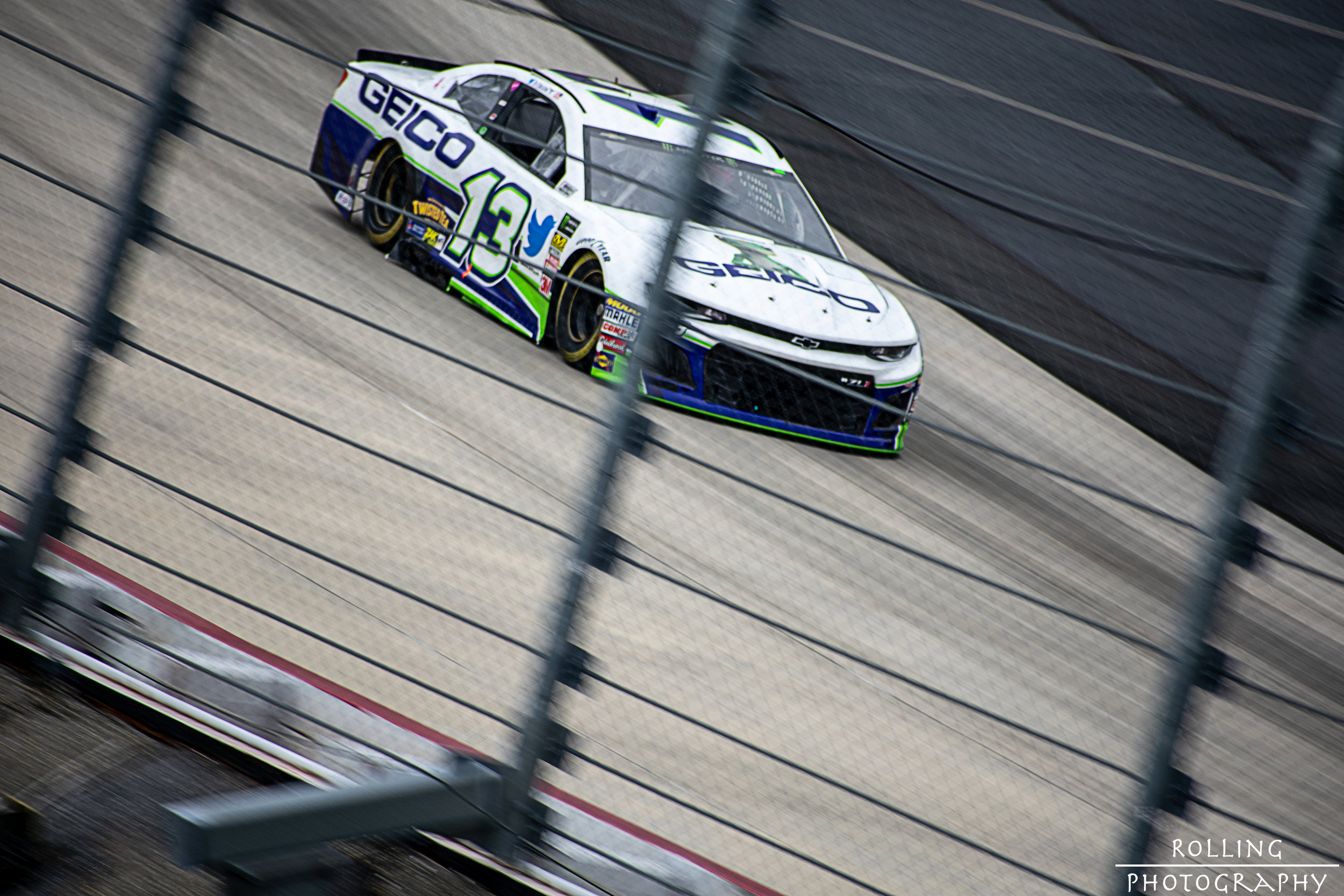 #13 Ty Dillon out out of Dover 4 onto the grandstand straight ISO 100, 70-300mm lens (300mm), f / 6.3 Shutter Speed 1/160