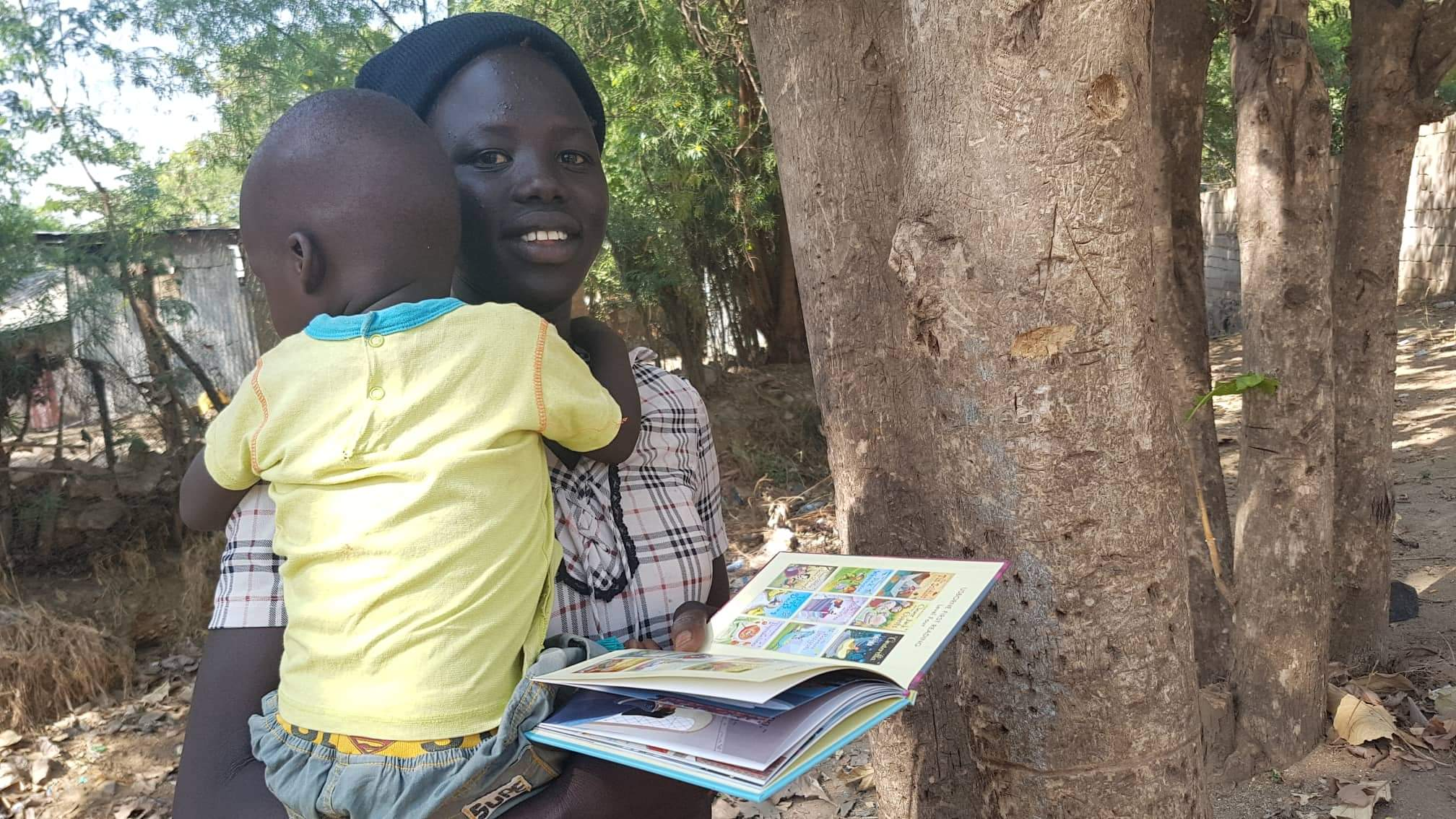 A family receives their first book in Juba, South Sudan.