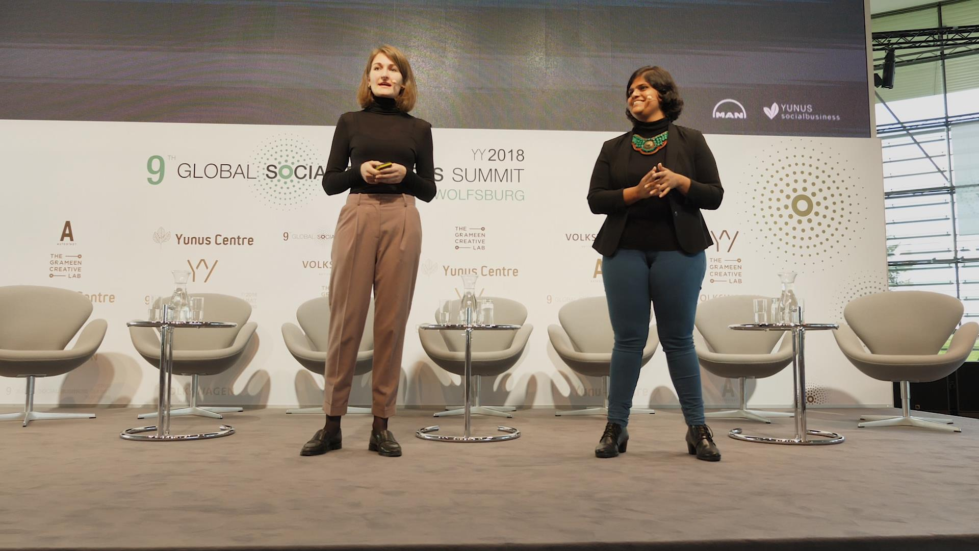 Lisa-Katharina Guggenmos and Arunima Singh (YSB Accelerator lead), introducing the program at the Global Social Business Summit in Wolfsburg, Germany