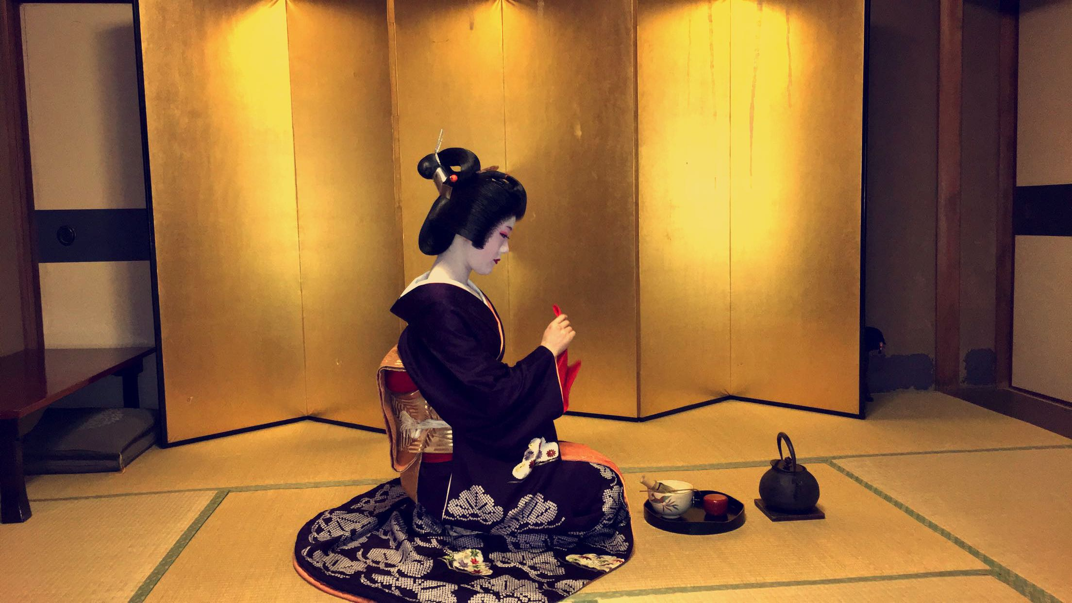 A traditional tea ceremony with a geisha in Kyoto, Japan, 2017.