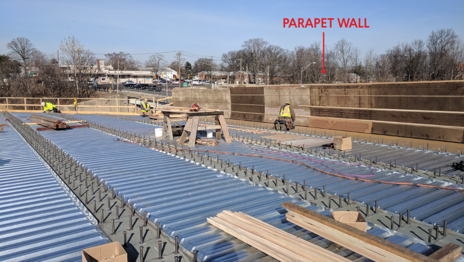 Carpenters are working to form the parapet walls and the pier\abutment ends of the deck.  Taken on 03/28/19 by Jonathan Wu