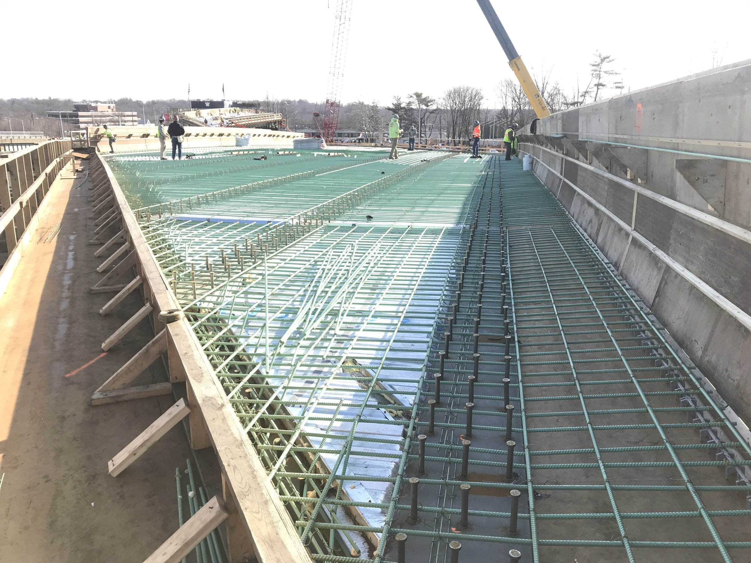 Ironworkers are installing the bottom mat of epoxy rebar for Span 2. Each bridge deck has two levels of epoxy rebar and the bottom mat alone weights 40,000 lbs!  Taken on 3/28/19 by Yousif Abdulla