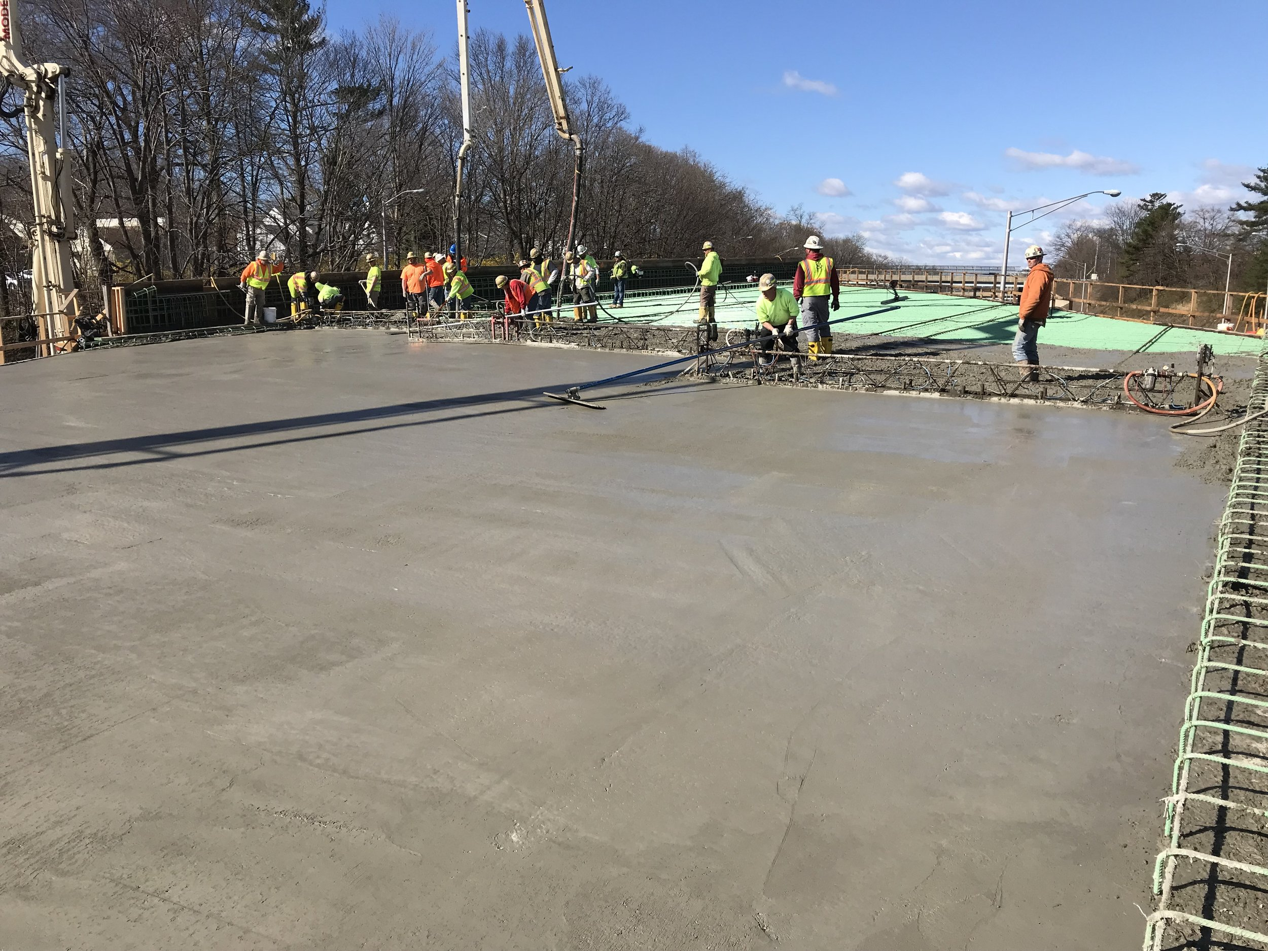 The contractor finishes the top of the concrete on Span 2 by making it a smooth surface.  Taken on 4/10/19 by Yousif Abdulla