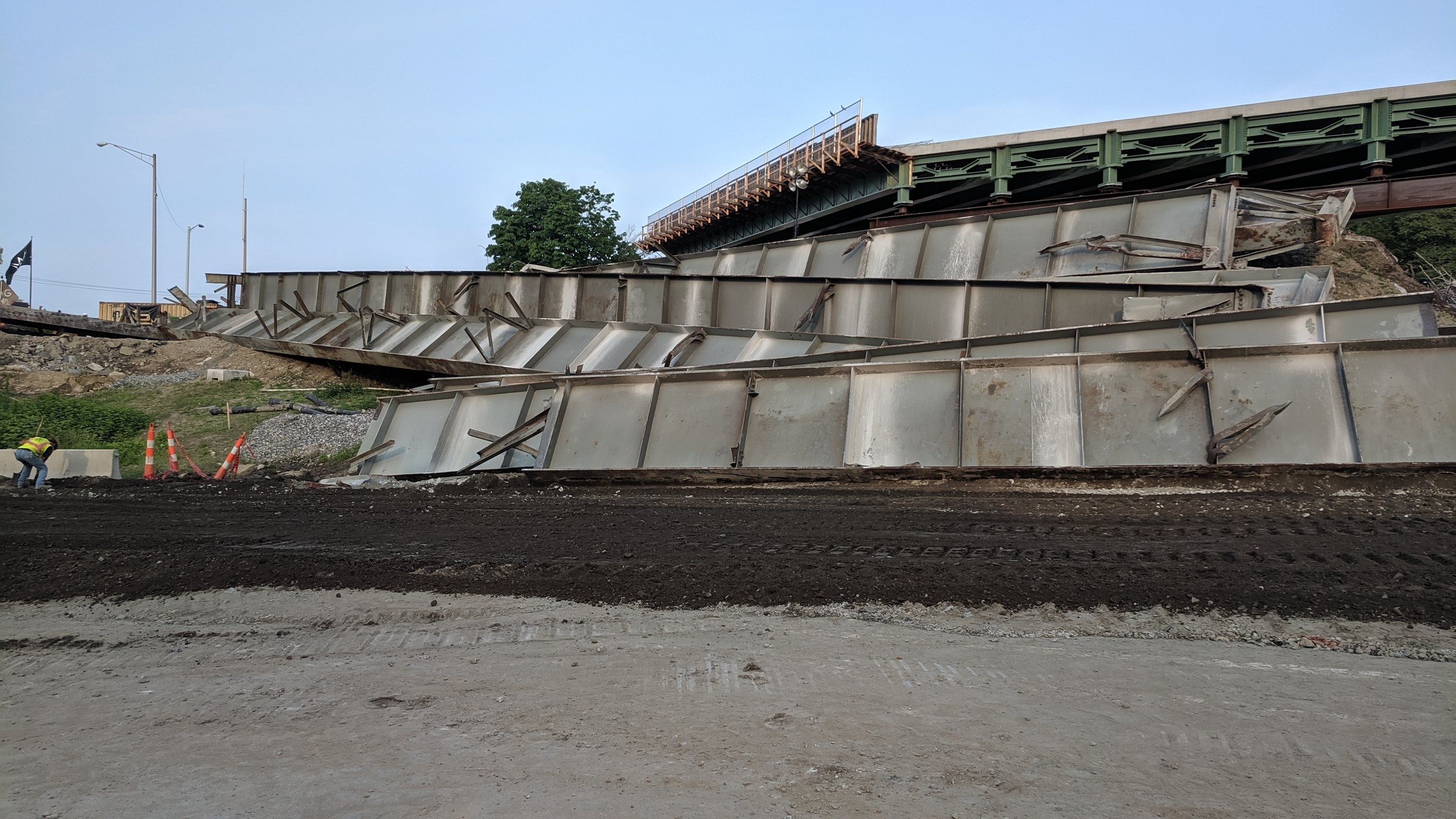 Steel girders from old bridge span await recycling.  Taken on afternoon of 6/2/19 by Jonathan Wu