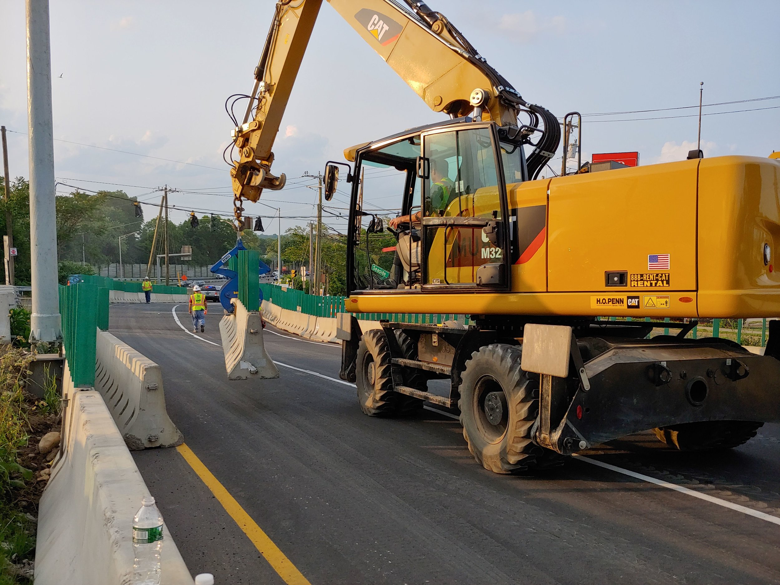 Removing barriers from temporary roadway.  Taken on afternoon of 6/2/19 by Jill Barrett