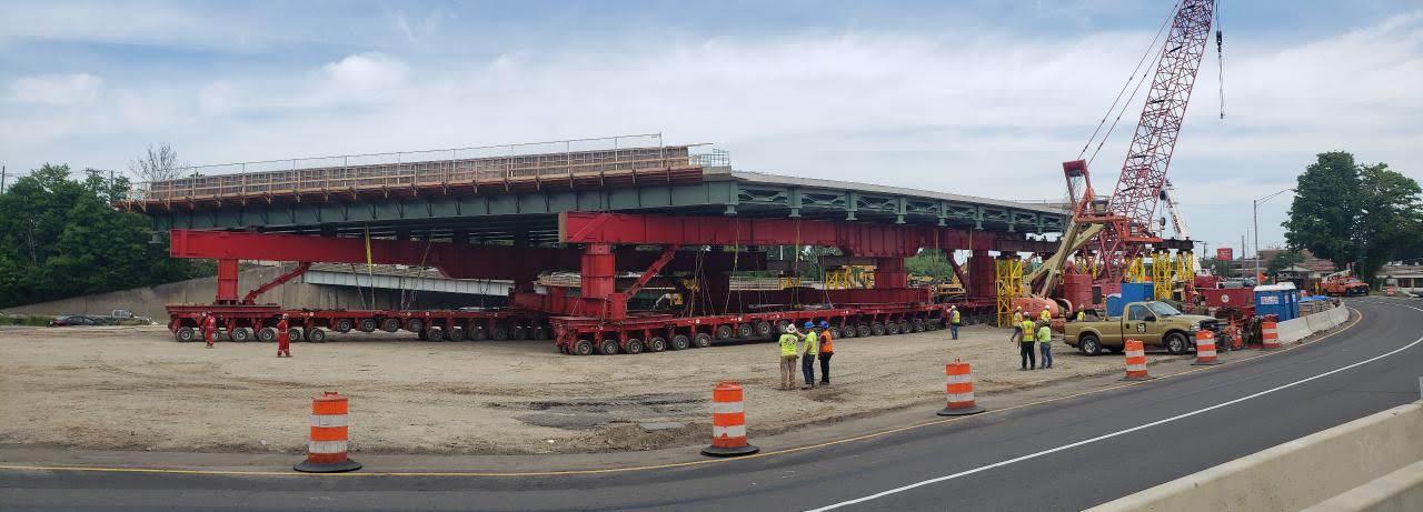 SPMT machine supporting bridge Span 1.  Taken on 6/7/19 by Lou Eveno