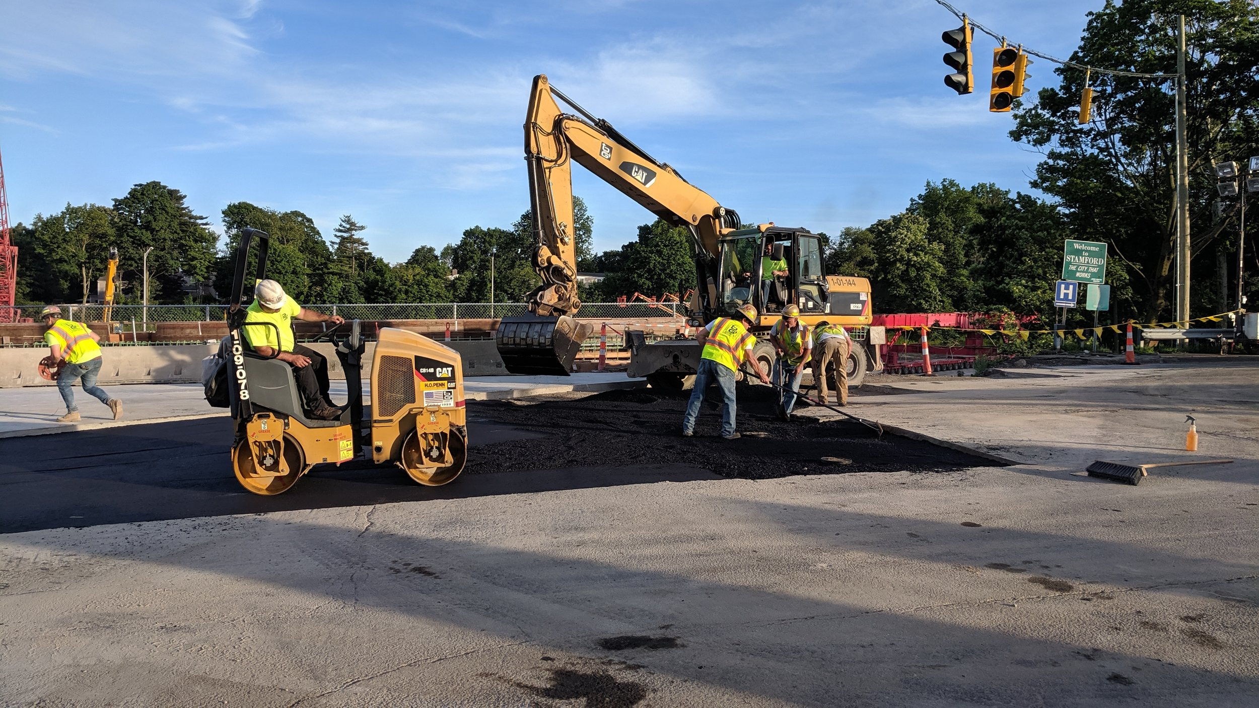 Workers installing temporary pavement for the approach from the West.  Taken the afternoon of 6/9/19 by Jonathan Wu