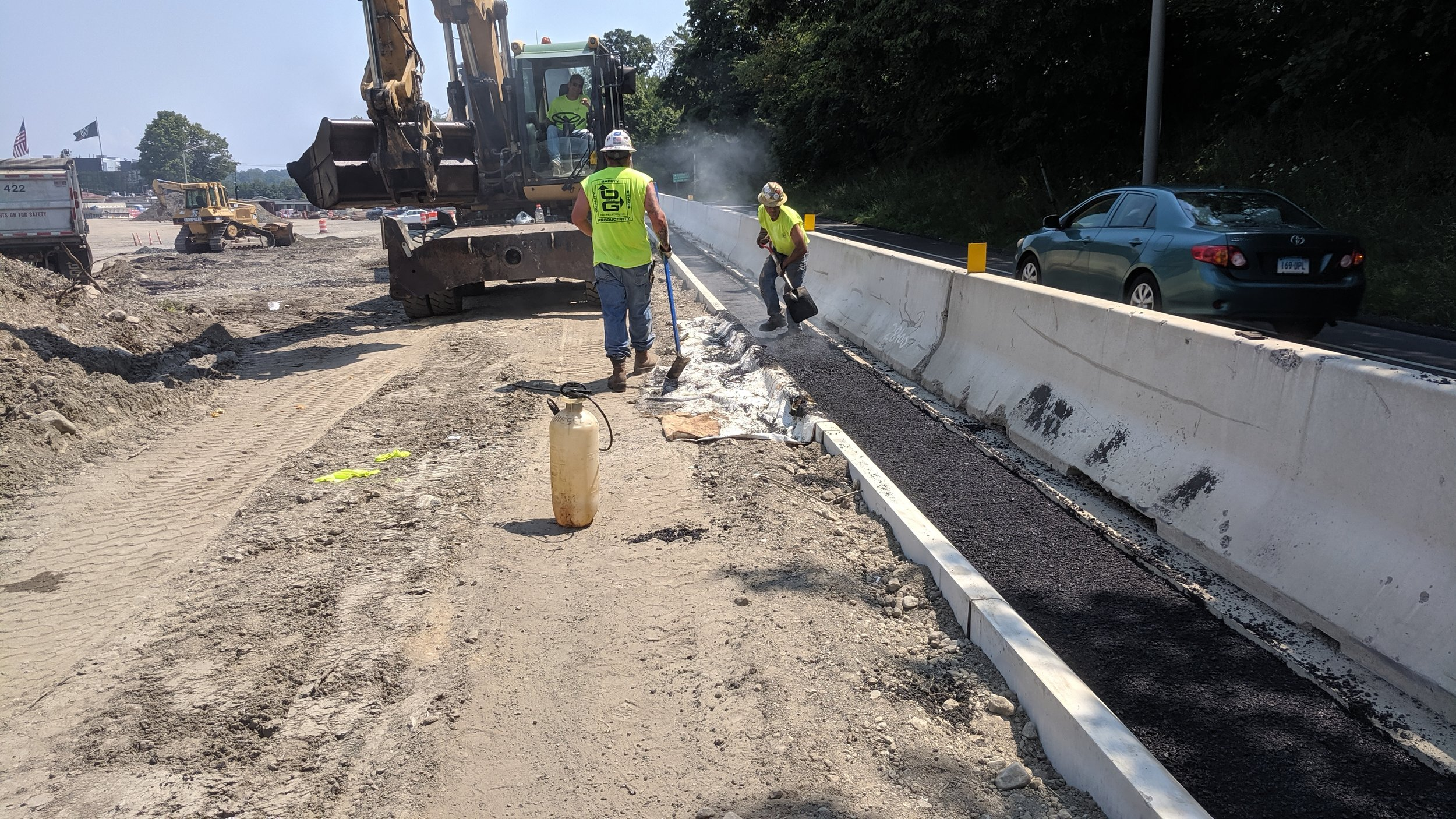 Installing new concrete curbing along Northbound off-ramp at Seaside Avenue  Taken of 8/1/19 by Jonathan Wu