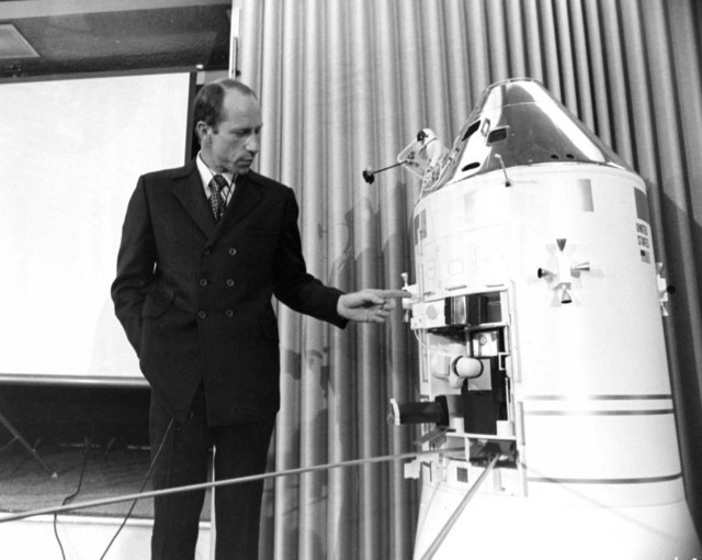 Explaining the SIM bay operations to the press using a model of the command and service module, 1971.