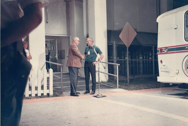 Deke Slayton shakes hands with my father before we come down the ramp to the launch pad on launch day. My sister Carolyn is on the far left.