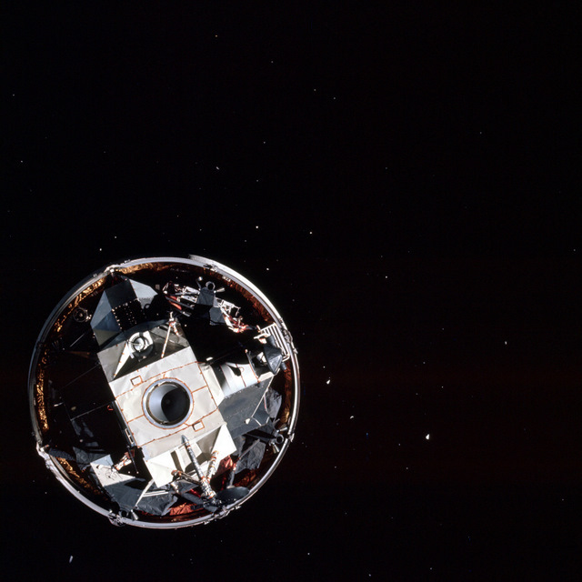 Docking with and extracting the Lunar Module in space.