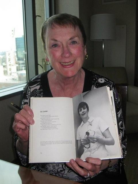 My friend Dee O'Hara with the poem I wrote about her.
