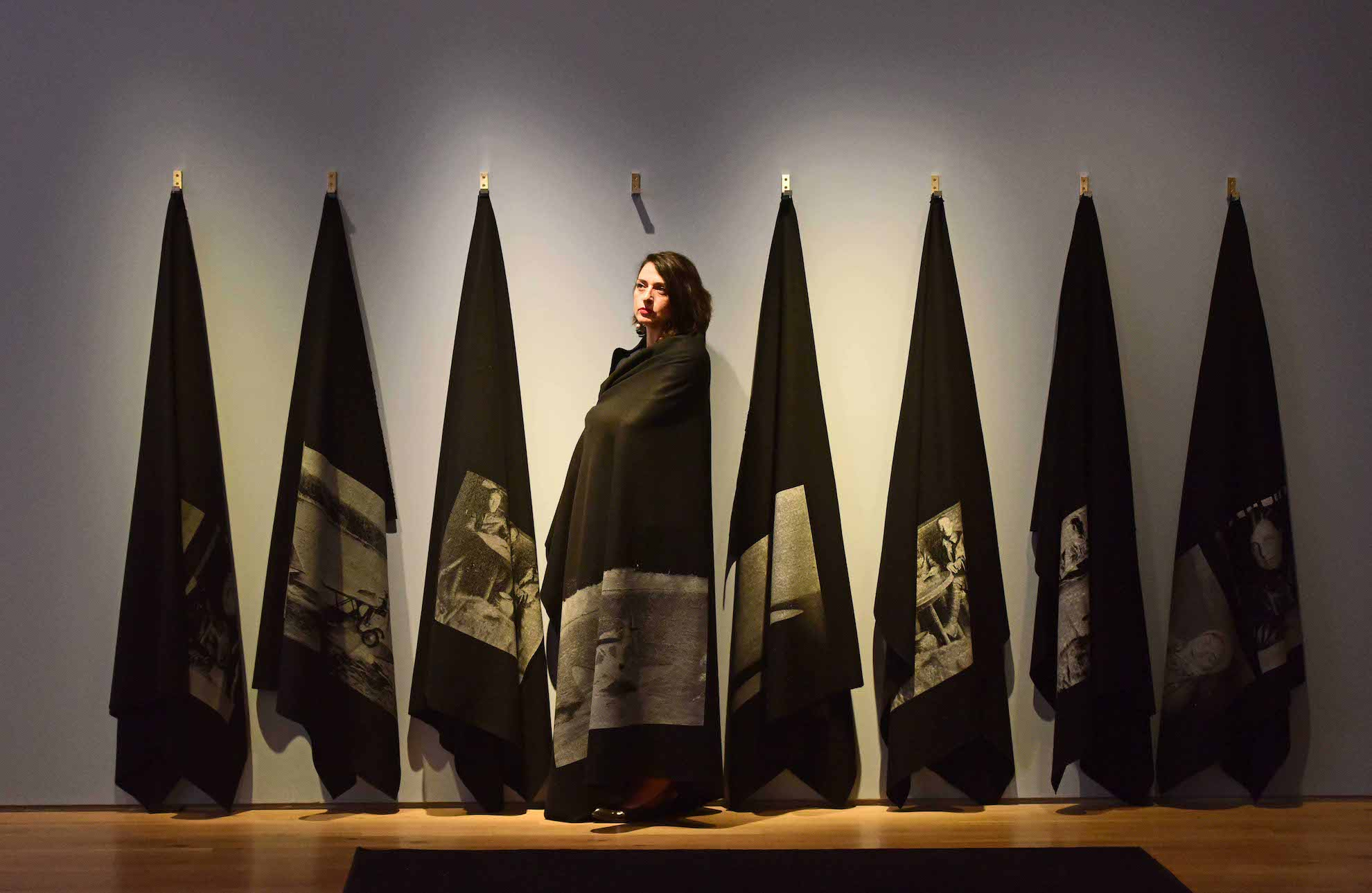 Blankets Project   2018 Eight felt blankets, screen print, metal hinges Overall dimensions 10 metres 1.9 metres by 20cm  The Sea is the Limit  exhibition at York Art Gallery, installation view