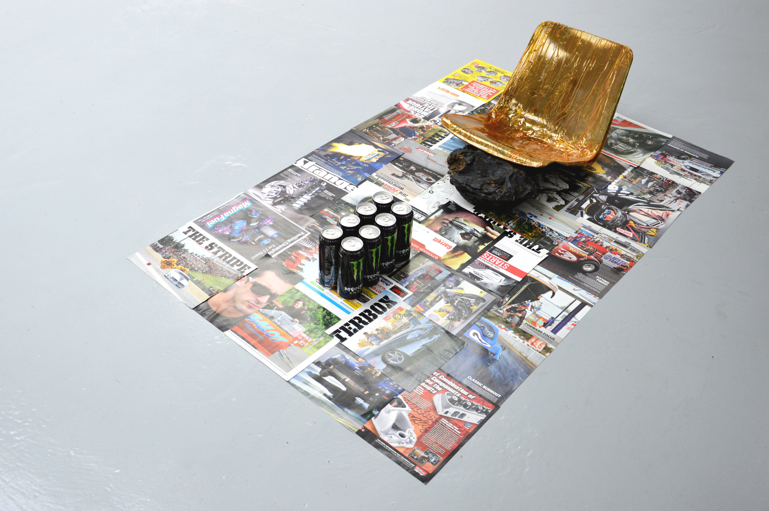 Peak Particle Velocity:   2018 Drag Illustrated cut-outs, HDPE seat, oxidized bitumen, polyimide tape, Monster Energy cans 500ml & spoken word 162x84x41cm