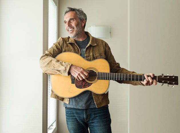 """John Wort Hannam - Recent years have seen a great deal of change in John's life - becoming a Dad, turning 50, a move to the """"big city"""" of Lethbridge, a long, deep bout of depression, and episodes of losing his singing voice. But John has emerged a better songwriter, a better singer, and a better player. On Acres Of Elbow Room, John has further refined his lyrical style and has landed squarely on his niche in the folk-roots world. He's spent years learning the craft of songwriting and is taking those tools to write some of his most personal songs. He has, quite literally, found his voice.FACEBOOK 