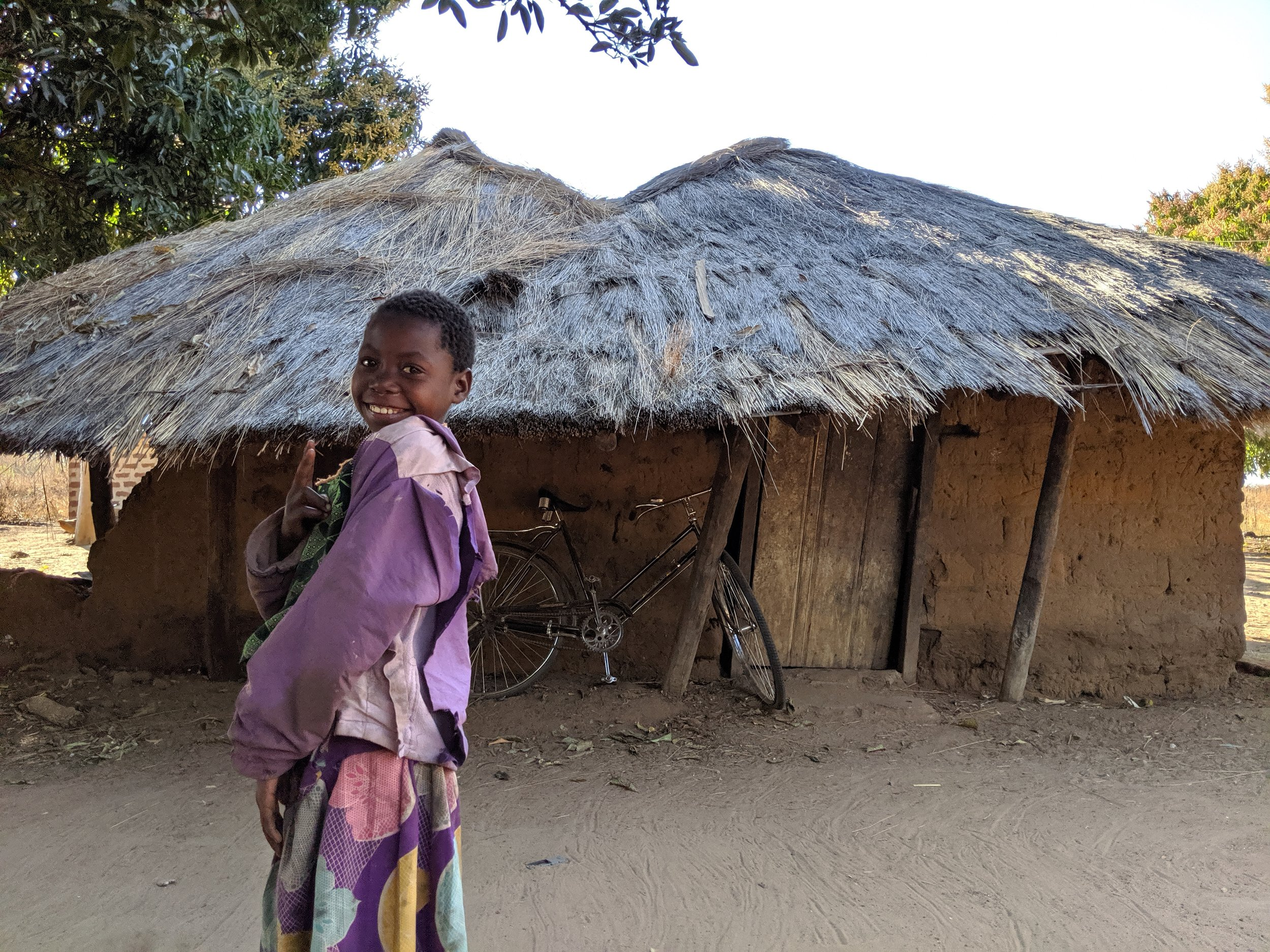 Another of Charles's family's houses. The girl pictured is one of the daughters of the piggery caretakers. She's always smiling and singing to herself. She and her sisters have very pretty singing voices.