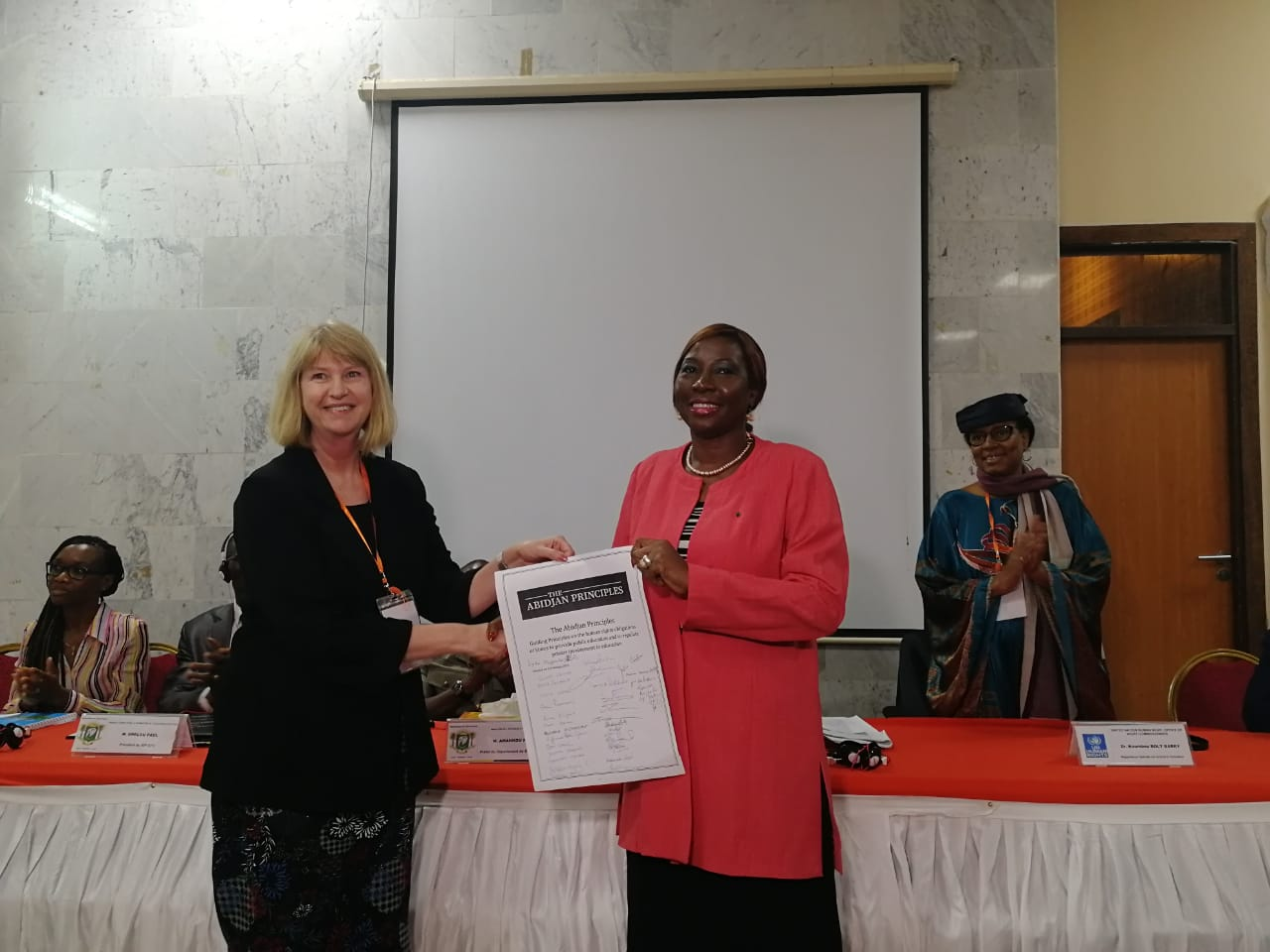 Professor Ann Skelton, chair of the drafting committee, handing over the Abidjan Principles to the Minister of Education in Abidjan on 13 February 2019.