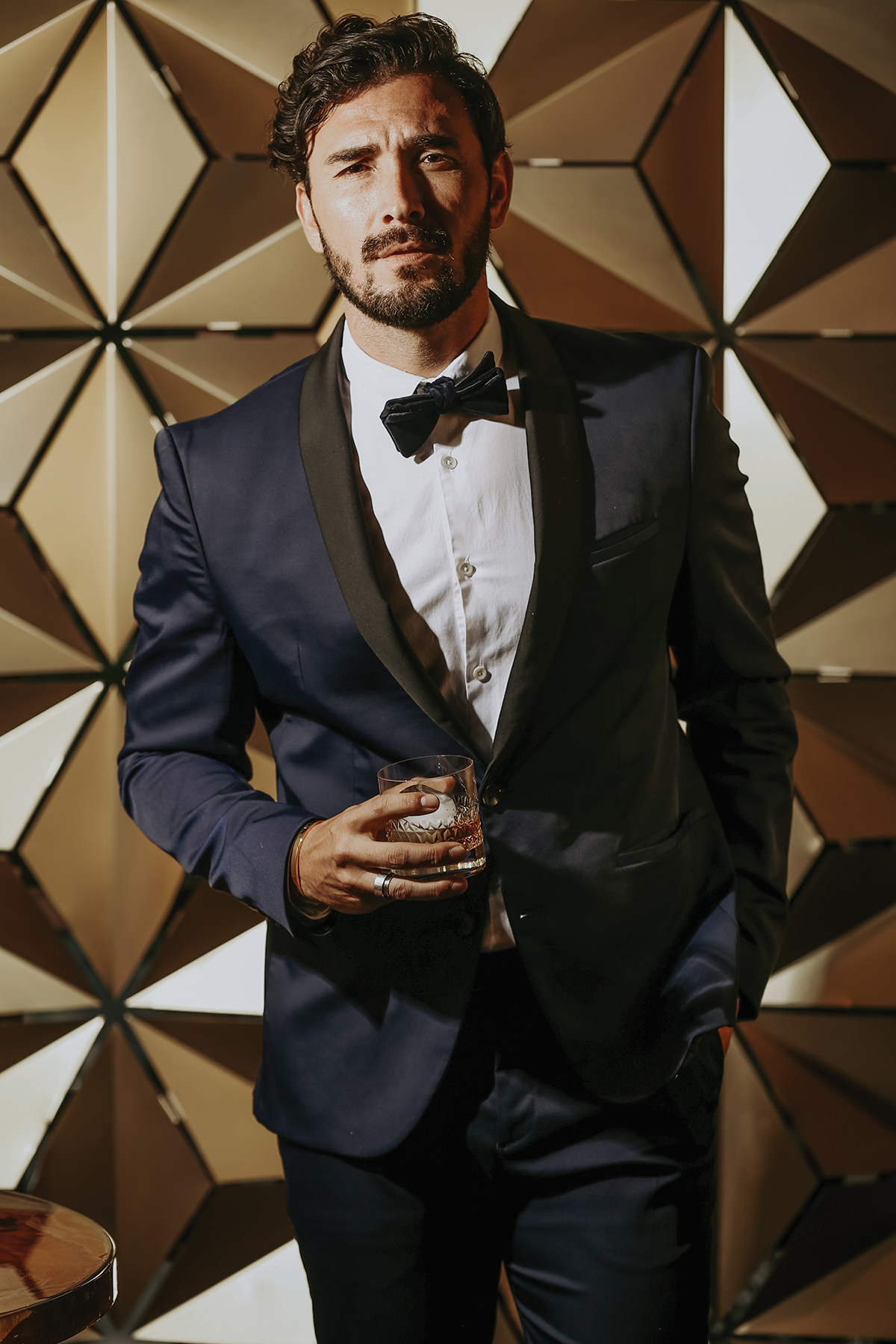 """The Vow FactorAll is fair in love and wardrobe - There are nuptial necessities for guy-style, too. Fashion-forward menswear is mandatory. The focus is on a slim-fit, long sleeves, and a suit that's true to size. """"Tuxes are streamlined and have defining details that make the jacket stand out,"""" says Michael Barone, owner of MODA. """"Standout details — such as buttons, flap pockets, and basic structure."""" As for weddings, Barone suggests even the guests wear a jacket no matter where the venue. """"Even if the wedding is in a barn, wear a jacket. And, if it's happening at a country club you better have on a tie. And, wear your shirt tucked in. Untucked shirts should stay at a house party, not a wedding."""