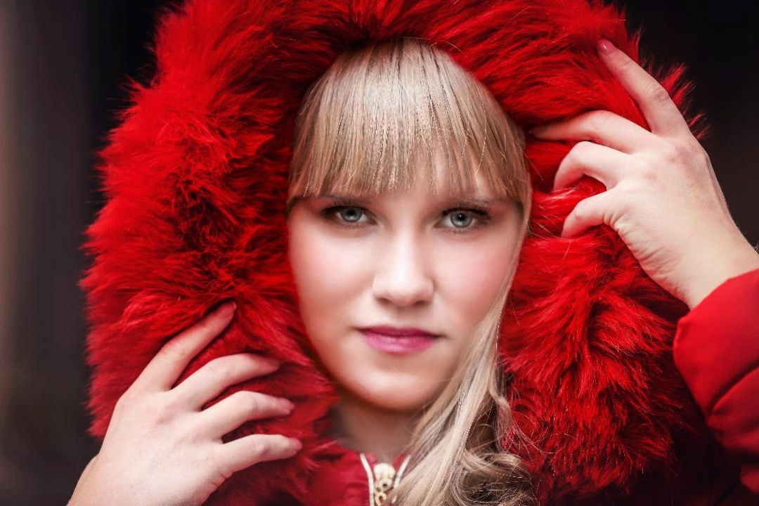 Elaina headshot with fur  collar(2).jpeg