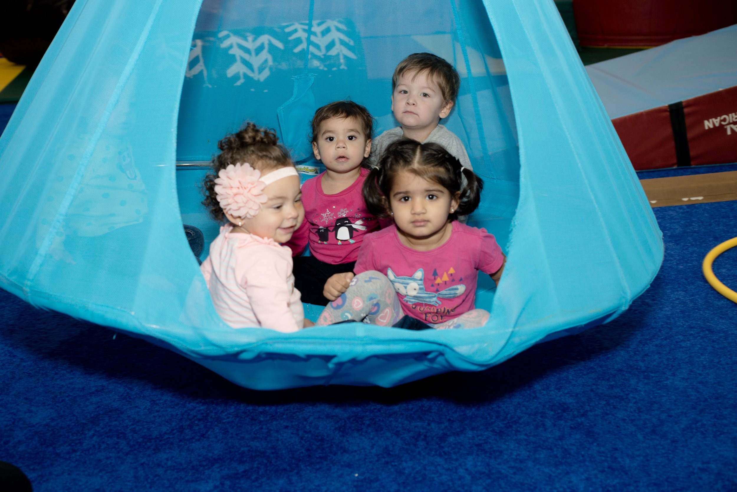 Explorers | 22 - 36 Mo - With parent, we climb, jump, balance, throw, and so much more. A wonderful experience for you and your child. Teachers take special care to show adults proper spotting techniques so tumbling can be practiced at home. Play with friends on our special toddler gym equipment all to a new theme activity each week!