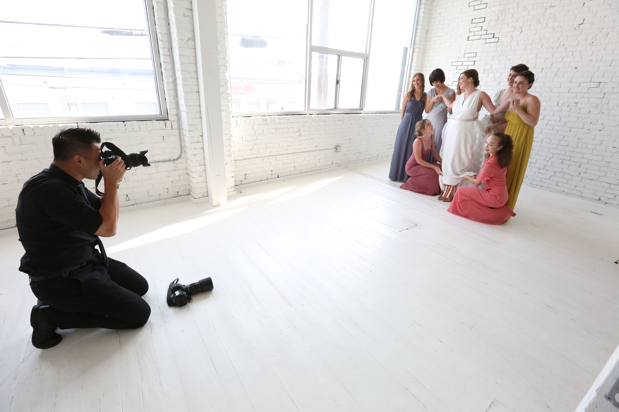 Photographers need personal branding just as much as anyone else — these behind-the-scenes shots of Henry Chen show how he works with brides and their bridal parties for formals.