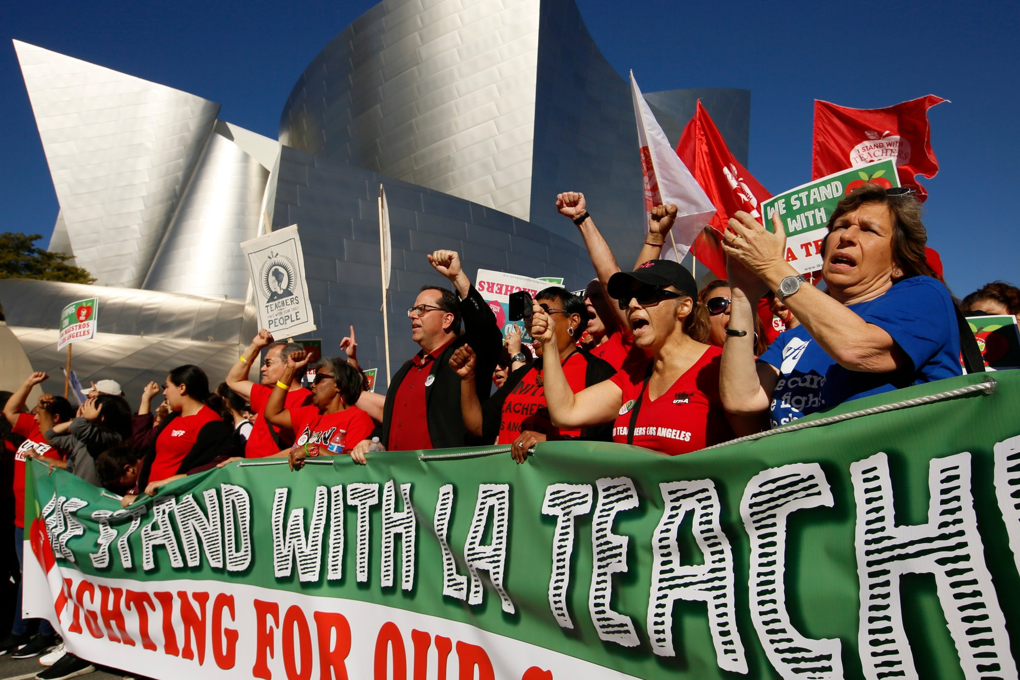 Alex Caputo-Pearl, the president of United Teachers Los Angeles, center, at a rally in December. Teachers in the Los Angeles Unified School District are expected to strike this week. Credit Damian Dovarganes/Associated Press