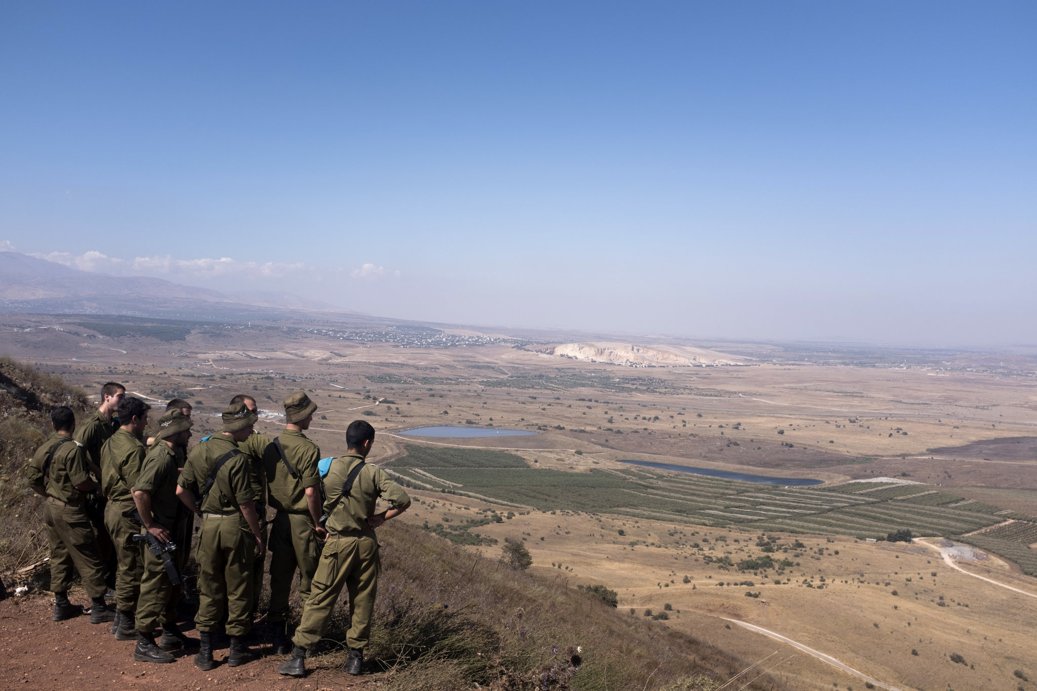 Israeli soldiers looking toward Syria from an observation point in the Golan Heights last year. Israel seized the Golan Heights from Syria in 1967. Credit Lior Mizrahi/Getty Images