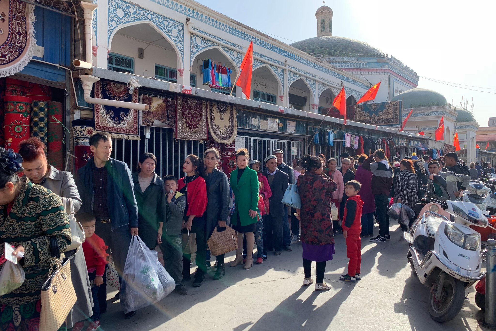 Shoppers lined up for identification checks outside the Kashgar Bazaar last fall. Members of the largely Muslim Uighur minority have been under Chinese surveillance and persecution for years. Credit Paul Mozur