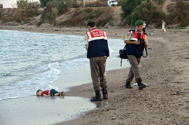 Turkish police document the scene where the body of 3-year-old Aylan was found Sept. 2, 2015. (Dogan News Agency / European Pressphoto Agency)