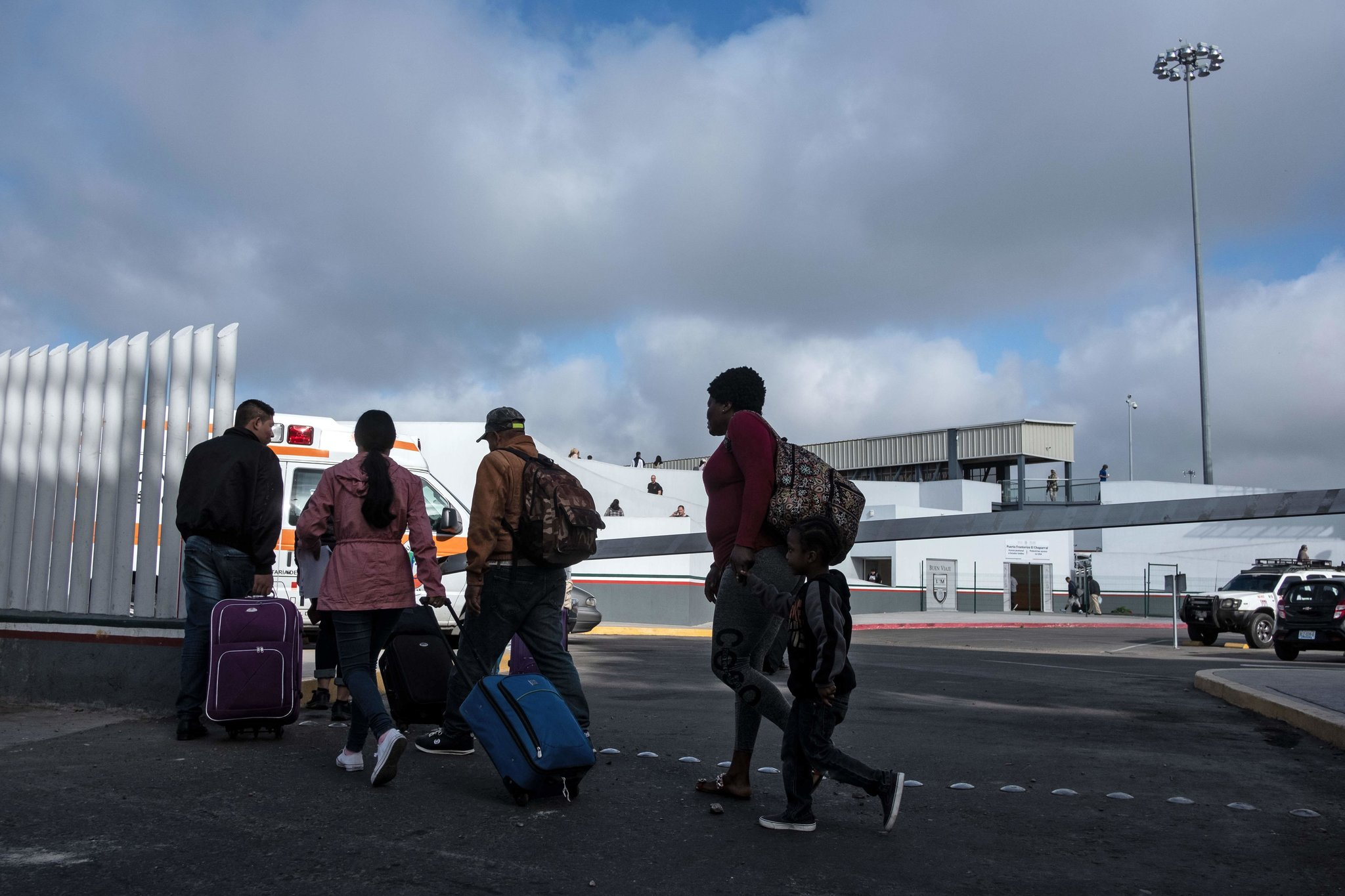 Asylum seekers last week in Tijuana, Mexico, at the El Chaparral port of entry. Credit Guillermo Arias/Agence France-Presse — Getty Images