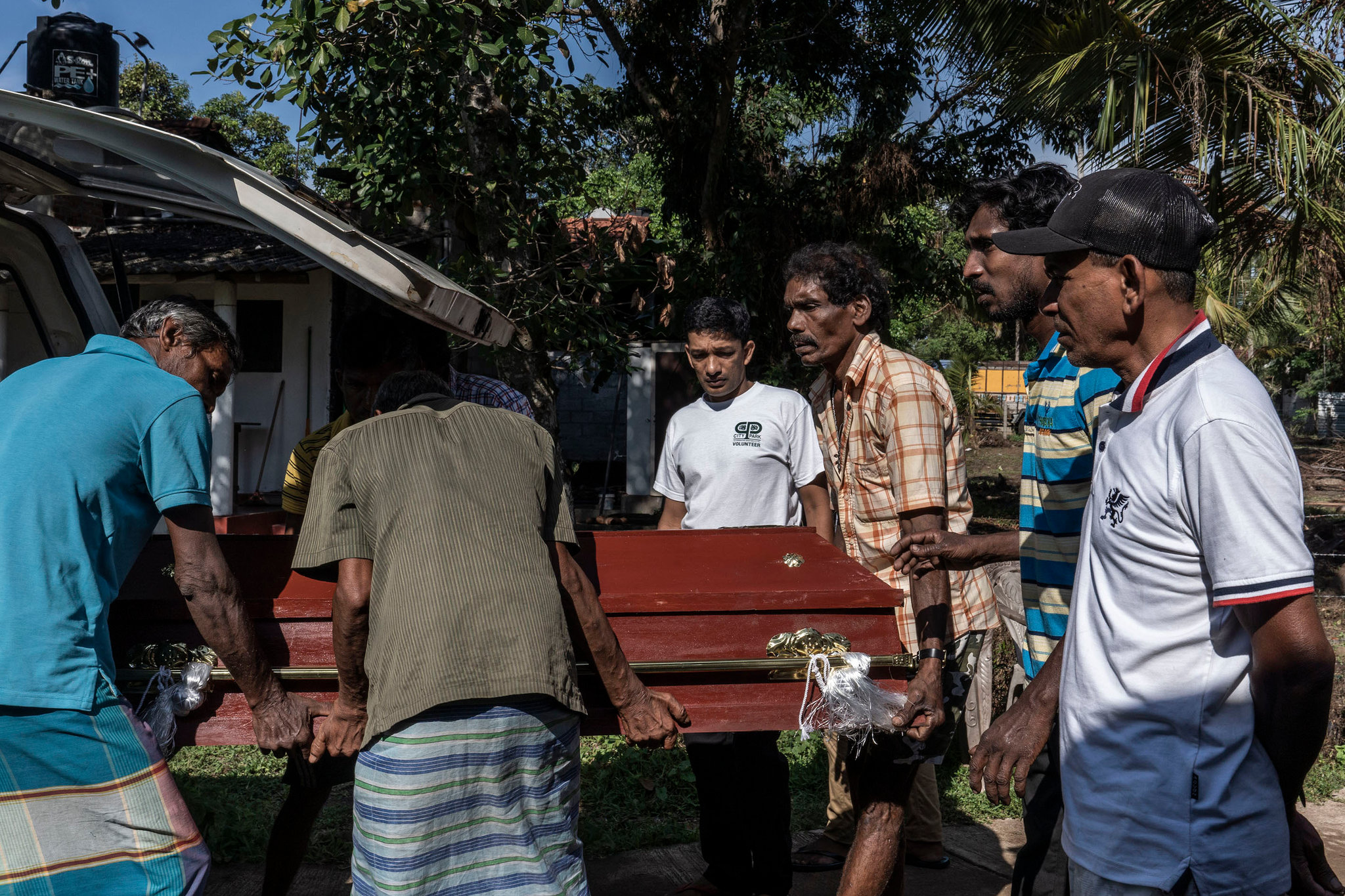 Relatives unloading the coffin on Monday of Sneha Savindi, 11, who was killed in a suicide bombing at St. Sebastian's Church in Negombo. Credit Adam Dean for The New York Times