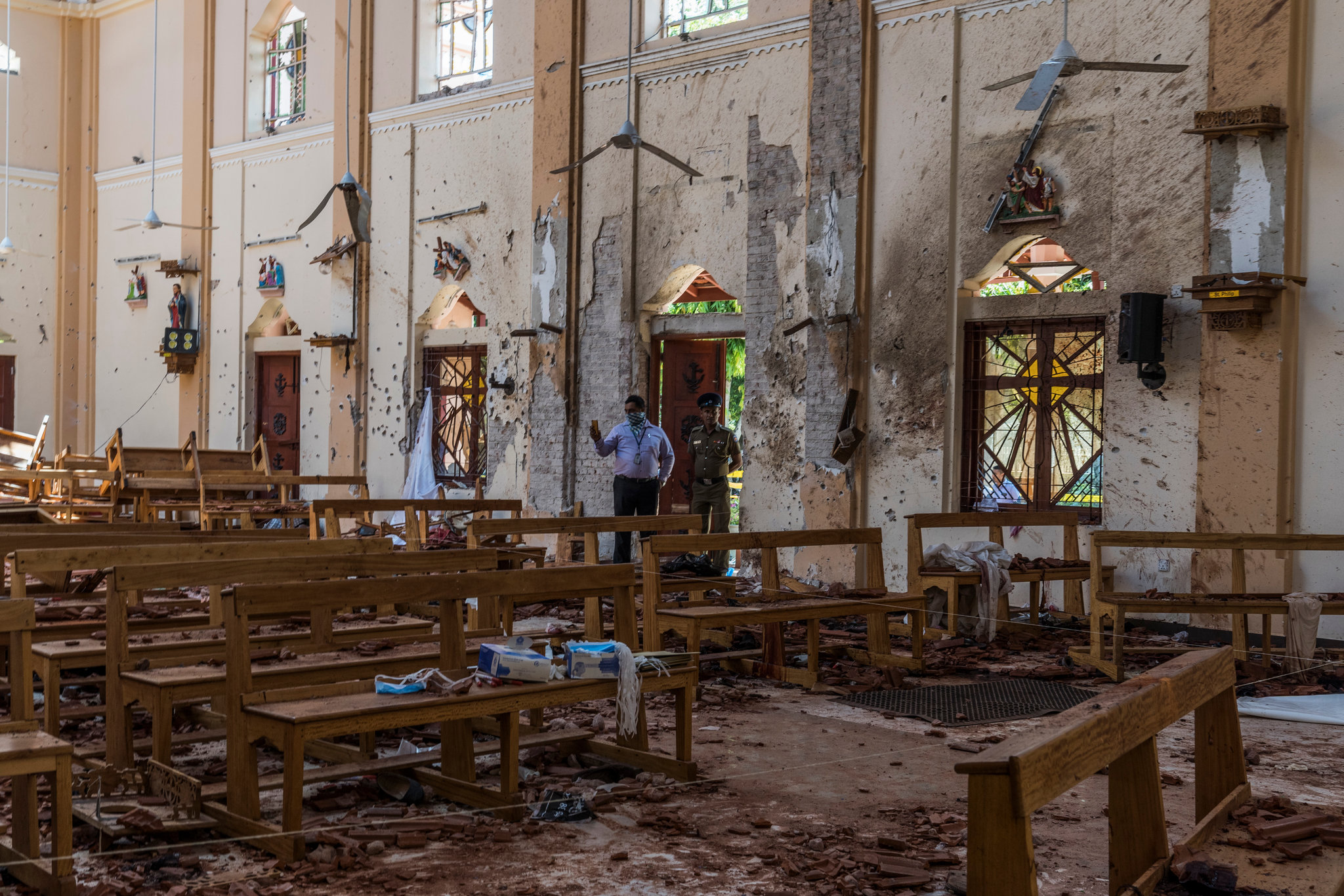 Surveying the damage at St. Sebastians Church in Negombo on Monday. Credit Adam Dean for The New York Times