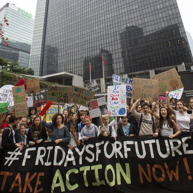 Climate strikes spread worldwide as students call for action – Hong Kong: Students protested outside the main government offices.
