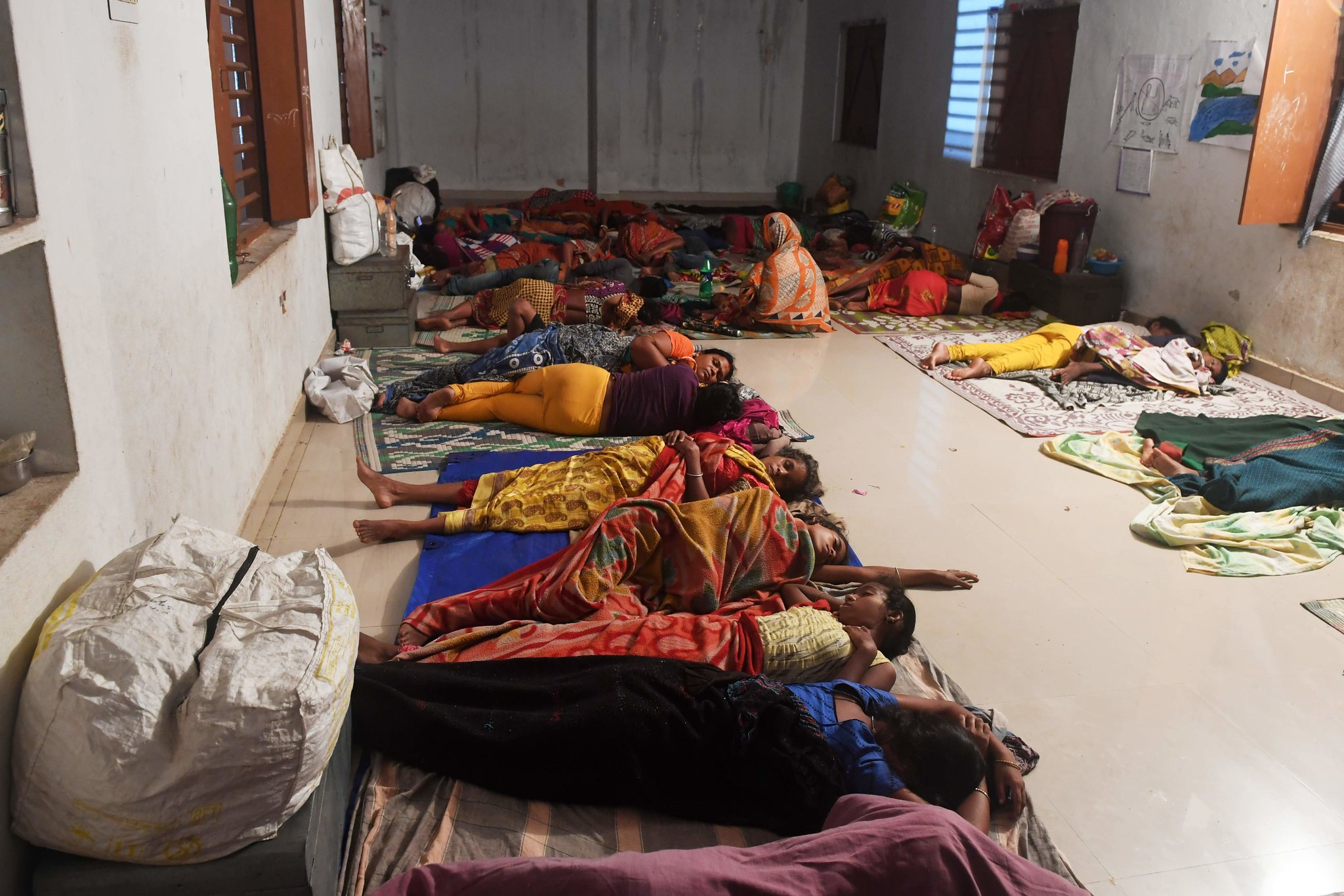 A cyclone relief shelter in Puri on Friday. Credit Dibyangshu Sarkar/Agence France-Presse — Getty Images
