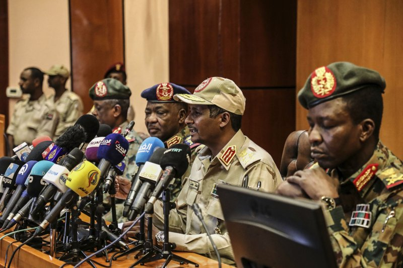 In this April 30, 2019 file photo, Gen. Mohamed Hamdan Dagalo, the deputy head of the military council, second right, speaks at a press conference in Khartoum, Sudan. As the uprising against Sudanese President Omar al-Bashir gained strength, Egypt, the United Arab Emirates and Saudi Arabia began reaching out to the military through secret channels to encourage his removal from power. (AP Photo)