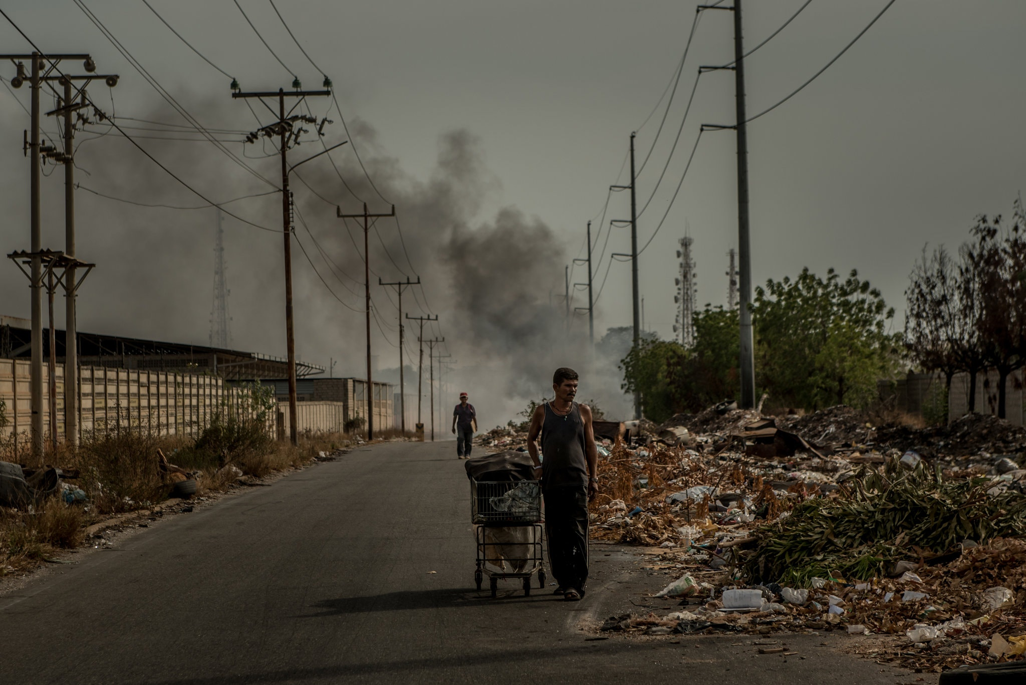 In Maracaibo, men searching for refuse that can be salvaged or recycled.Credit Meridith Kohut for The New York Times