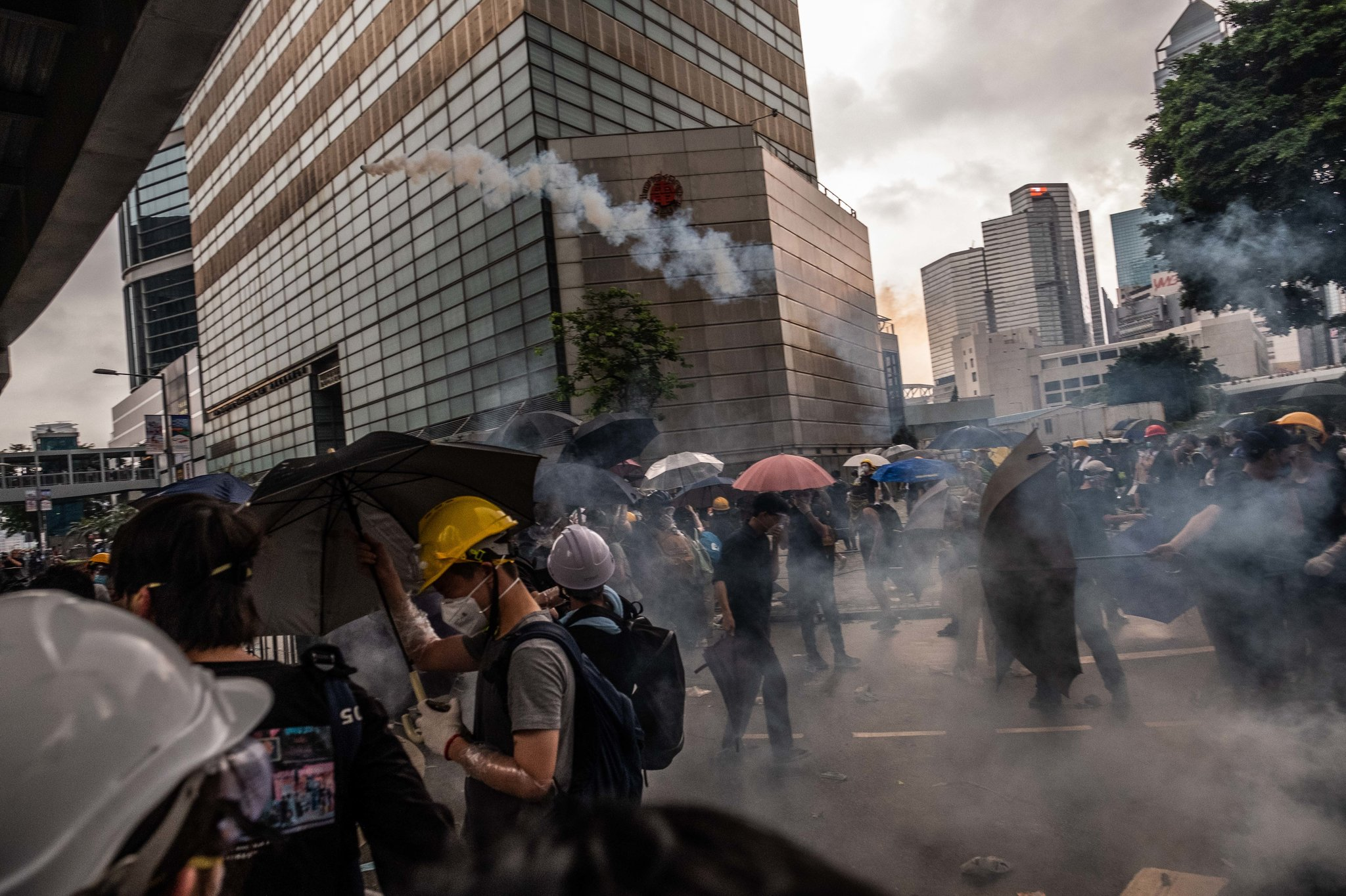 The Hong Kong police used tear gas on Wednesday as protesters approached the Legislative Council, where lawmakers had been scheduled to debate a contentious extradition law. Credit Lam Yik Fei for The New York Times