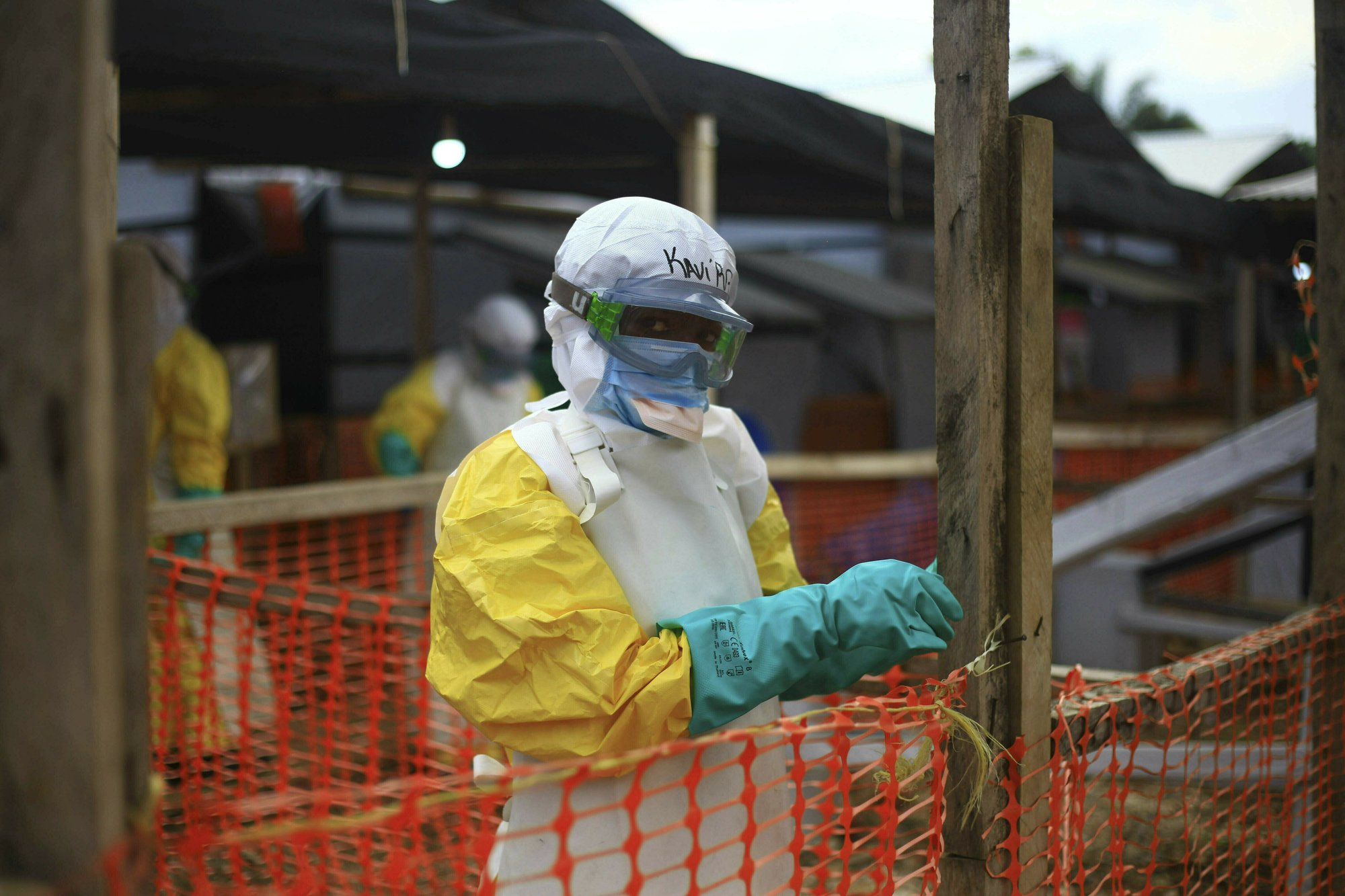 This Tuesday, April, 16, 2019 file photo taken in Congo shows an Ebola health worker at a treatment center in Beni, Eastern Congo. Uganda's health ministry said late Tuesday, June 11, 2019 that a 5-year-old Congolese boy who crossed into Uganda has tested positive for Ebola in what is the first cross-border case of the deadly virus since an outbreak started in neighboring Congo last year. (AP Photo/Al-hadji Kudra Maliro, File)