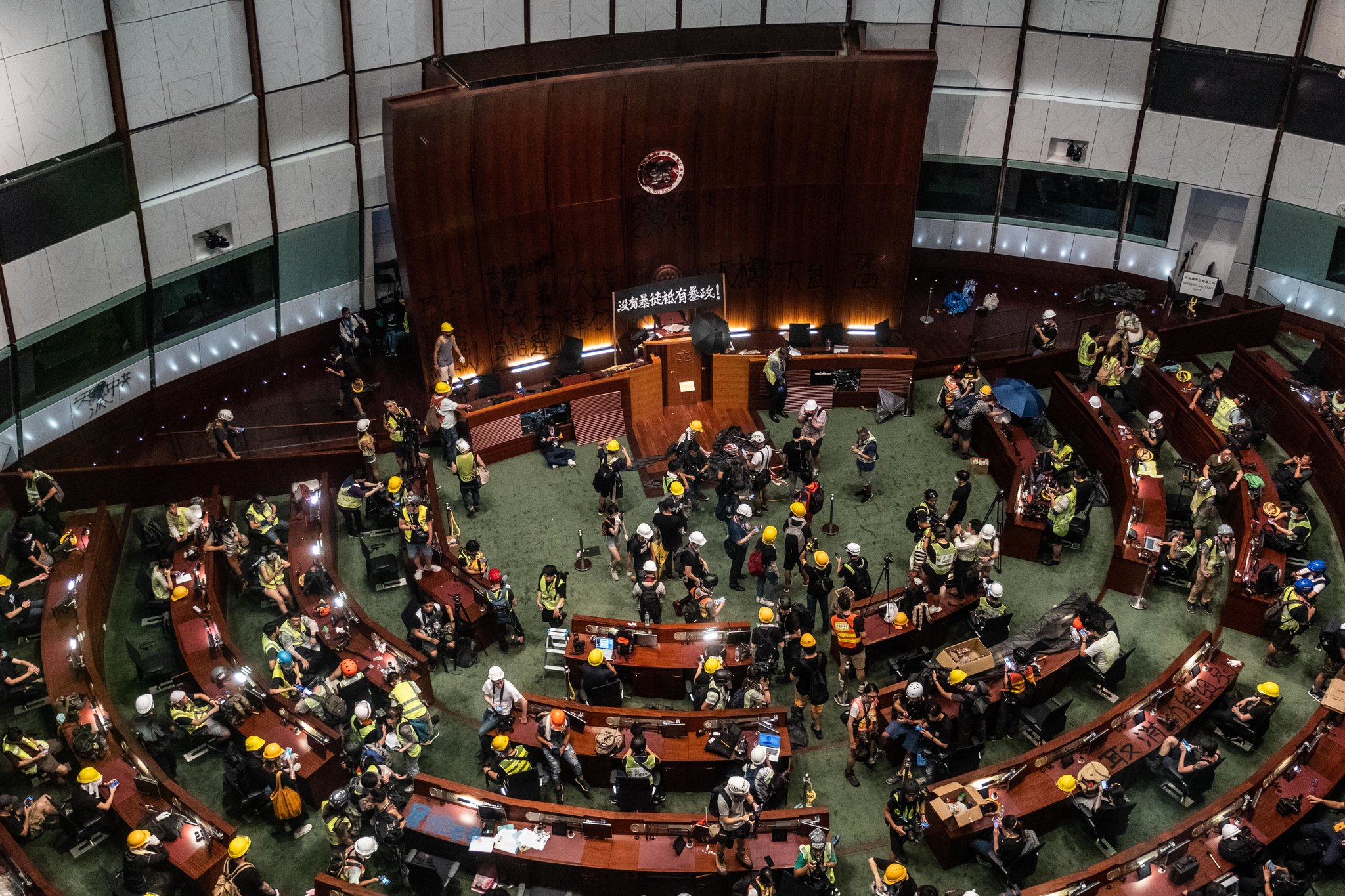 Protesters occupying the Legislative Council in Hong Kong on Monday. Credit Lam Yik Fei for The New York Times