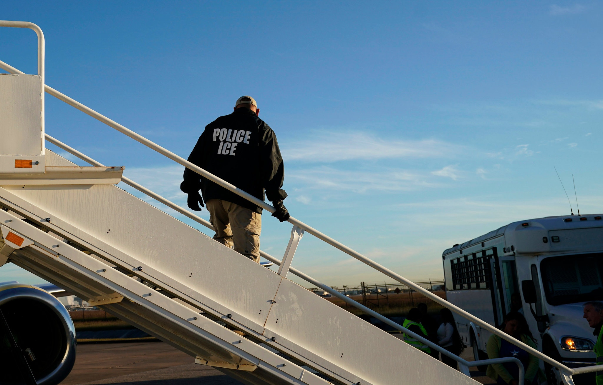 An Immigration and Customs Enforcement agent as deportations were being carried out in November in Houston. Credit David J. Phillip/Associated Press