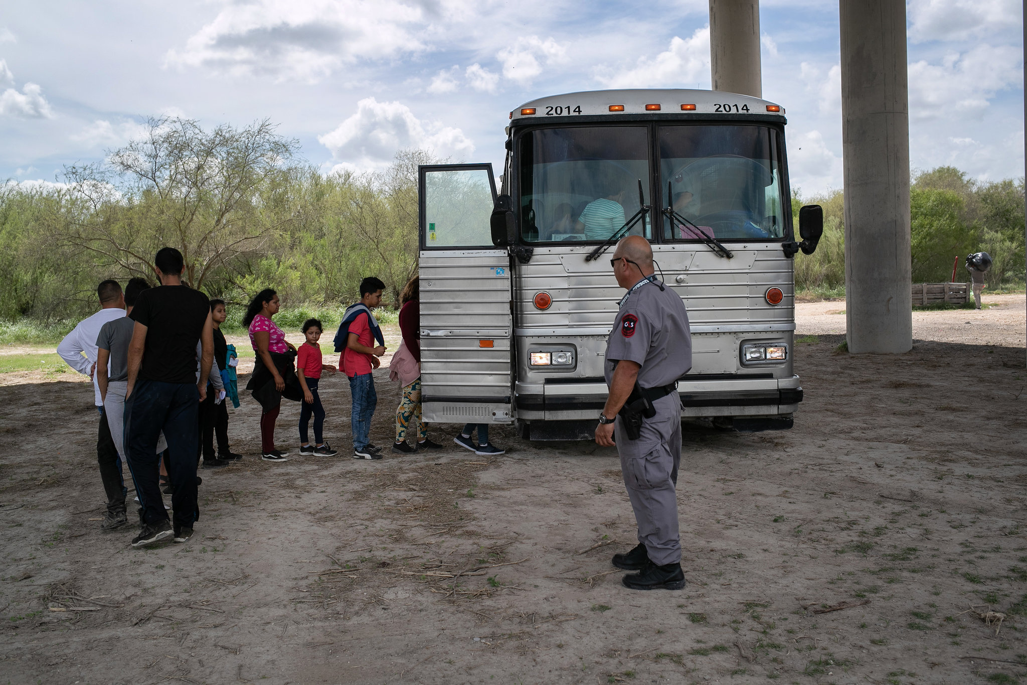 Migrants were driven to a processing center after they were taken into custody by Border Patrol agents earlier this month. Credit John Moore/Getty Images