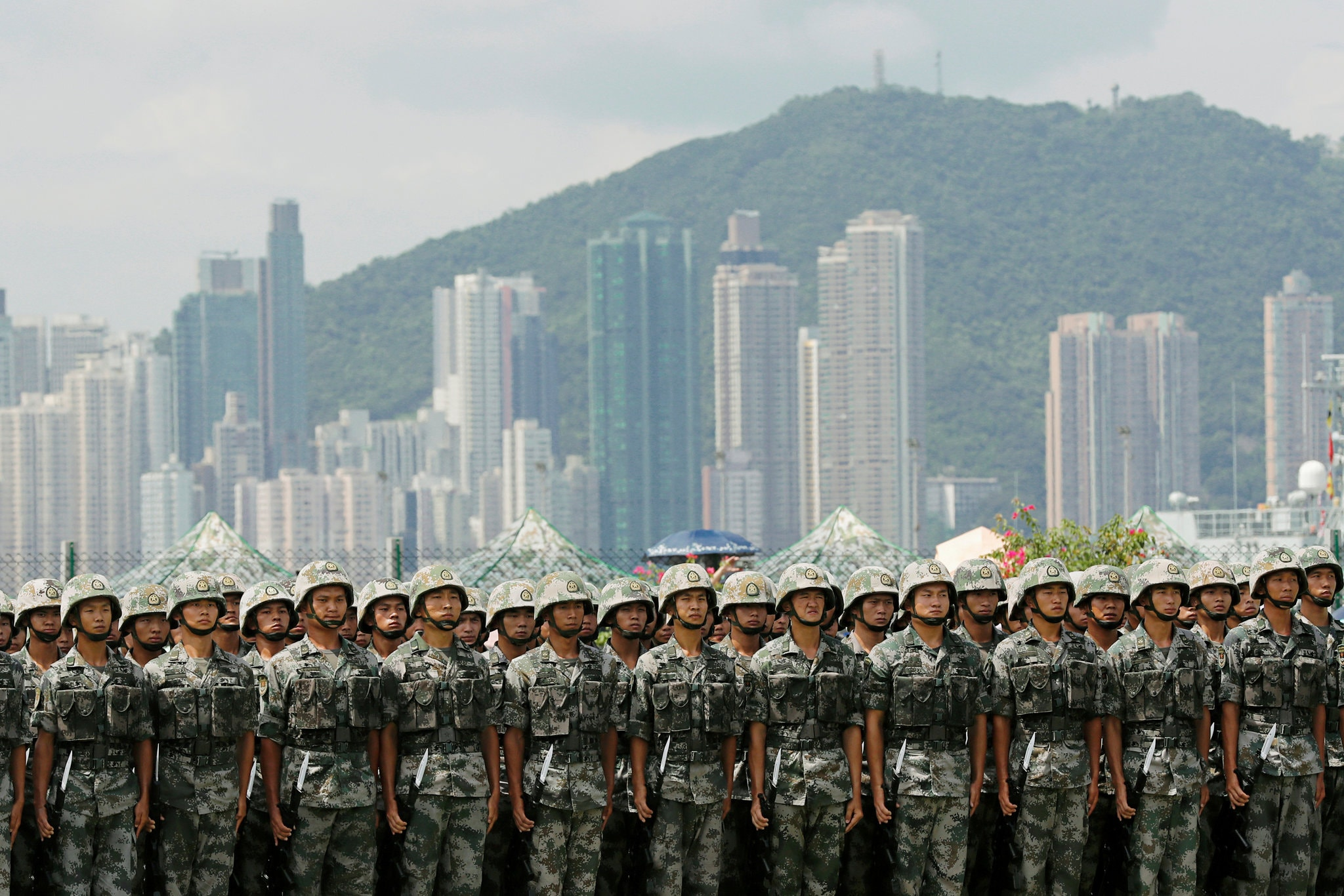People's Liberation Army soldiers at Stonecutters Island naval base in Hong Kong last month. China warned that it could mobilize Chinese troops to maintain order in Hong Kong. Credit Tyrone Siu/Reuters
