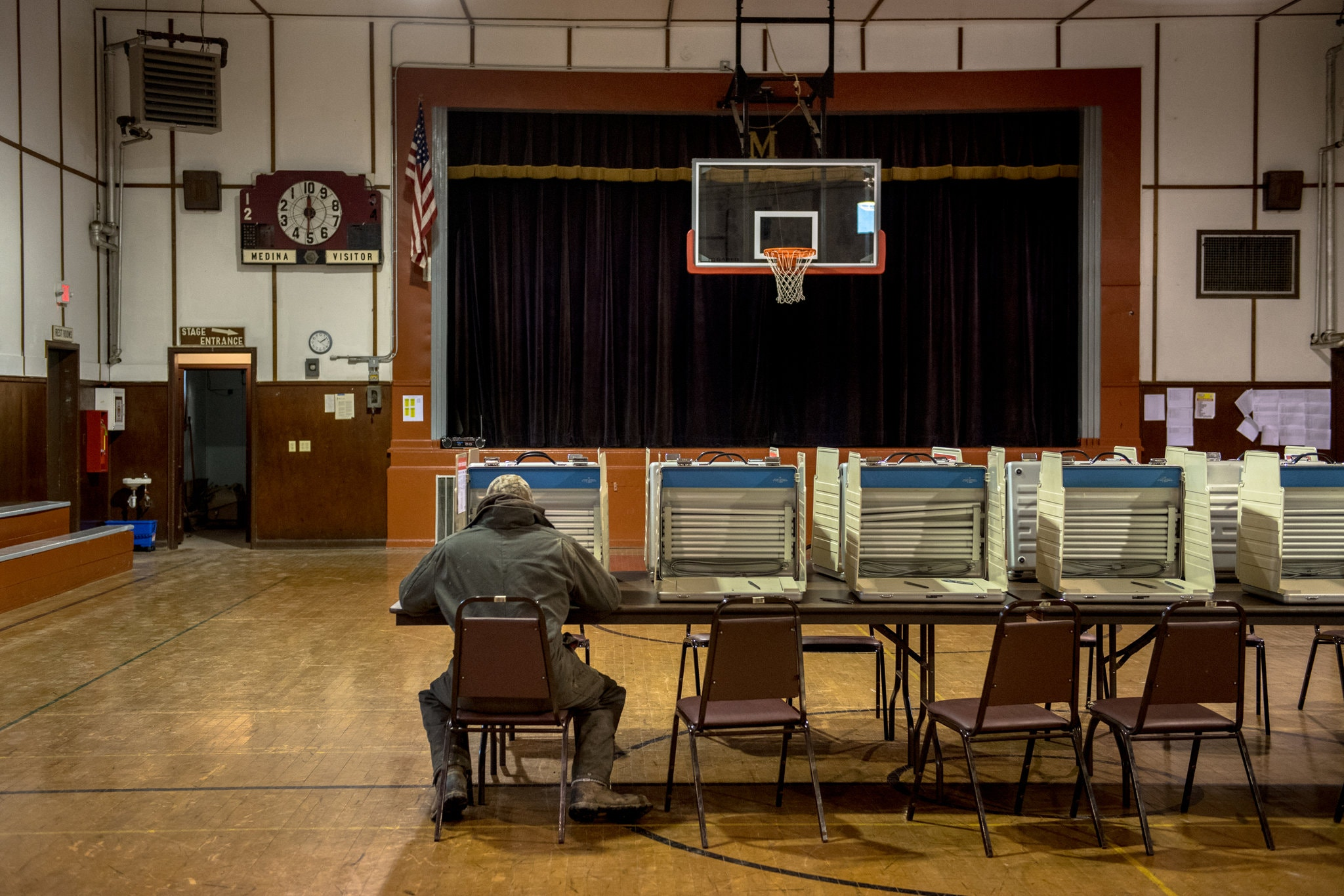 A voter casting his ballot in the midterm elections last year in Medina, N.D. Credit Hilary Swift for The New York Times