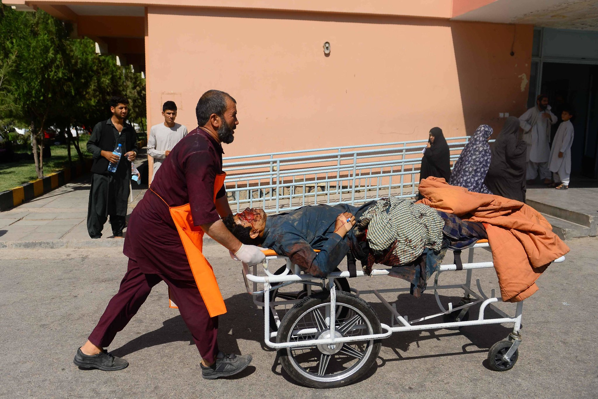 An injured man being transported on a stretcher on Wednesday after a bus hit a roadside bomb on the highway between the Afghan cities of Kandahar and Herat. Credit Hoshang Hashimi/Agence France-Presse — Getty Images